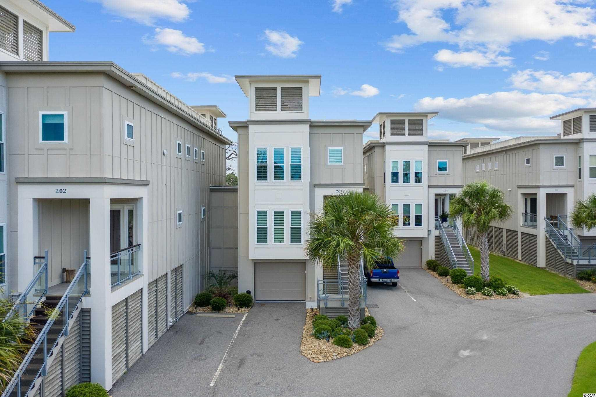 Magnificent like new home- tucked away in a small, gated community of luxury town-homes.  Across the street from Barefoot Landing, and steps to the sparkling blue Atlantic.  This immaculate like new 4 bedroom 4-1/2-bathroom Town-home is ready for you to start living the beach life.  This three-level home starts with the garage on the first floor, with a half bathroom, and 3 extra storage closets for everything you might need to put away, plus a humidifier inside the larger storage closet, there are two covered gated areas for recreation, either the children or pets be protected from the pool, cars, or sun. This covered area can be closed off by roll up door. The extra-large garage which has Hardy Board inside as well, plus has enough room for 2 cars and 2 golf carts to park. Your private saltwater pool overlooks the magnificent marsh and exotic wildlife of beautiful birds and palm trees, offering natural gas hook up for the fire pit and the grill,  with a spiral staircase that can take you up to the main living area, or you can take your private elevator or regular stairs up to your first floor living space, with a bedroom or you could use as an office and full bath offering a standalone bathtub, and shower, laundry room, the gourmet kitchen with natural gas stove and farmers Stainless steel sink, beautiful cabinets and a pantry, granite counters, and room to sit and eat at the bar on in the dining area.  Both kitchen and your family room overlook the beautiful views of the marsh with a veranda off from both areas, so you can entertain and be in or outside.  You can then go up the third floor and where you have two master suites and a third bedroom all having their own bathrooms.  Both master suites come with double sinks and walk in closets.  The Grand master has a veranda right off from the bedroom to enjoy the views. This home comes partially furnished, the extra fridge in the garage will stay for your convenience.   The home comes with Plantation shutters on all