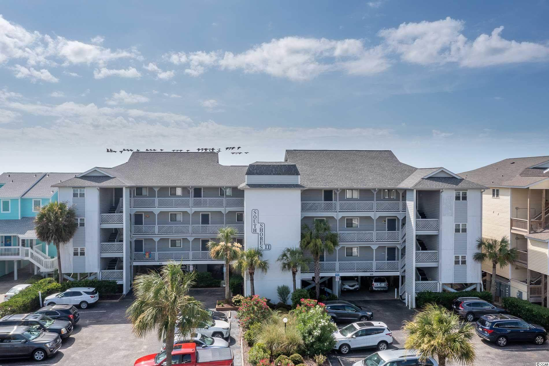 """Enjoy the ocean breezes and the direct oceanfront views of one of the most beautiful stretches of  beach on the Grand Strand from this updated condo at South Shores II in Surfside Beach. Unit 101 has waterproof luxury vinyl plank flooring, granite counter tops , a full sized washer and dryer, a newer impact resistant sliding glass door in the living room and a new HVAC unit outside. There is a storage room off of the balcony as well as a private Owner storage closet on the ground level to store beach chairs and beach """"toys"""". This well maintained complex offers an ocean front pool and grilling area as well as an ELEVATOR!  Enjoy fishing piers nearby and the restaurants and water sports offered at  the  Marsh Walk in Murrells Inlet...OR...take a short drive to enjoy all of the attractions and amenities in Myrtle Beach. Whether you are looking for a second home, vacation rental property or a primary residence, you don't want to miss out on this opportunity!"""