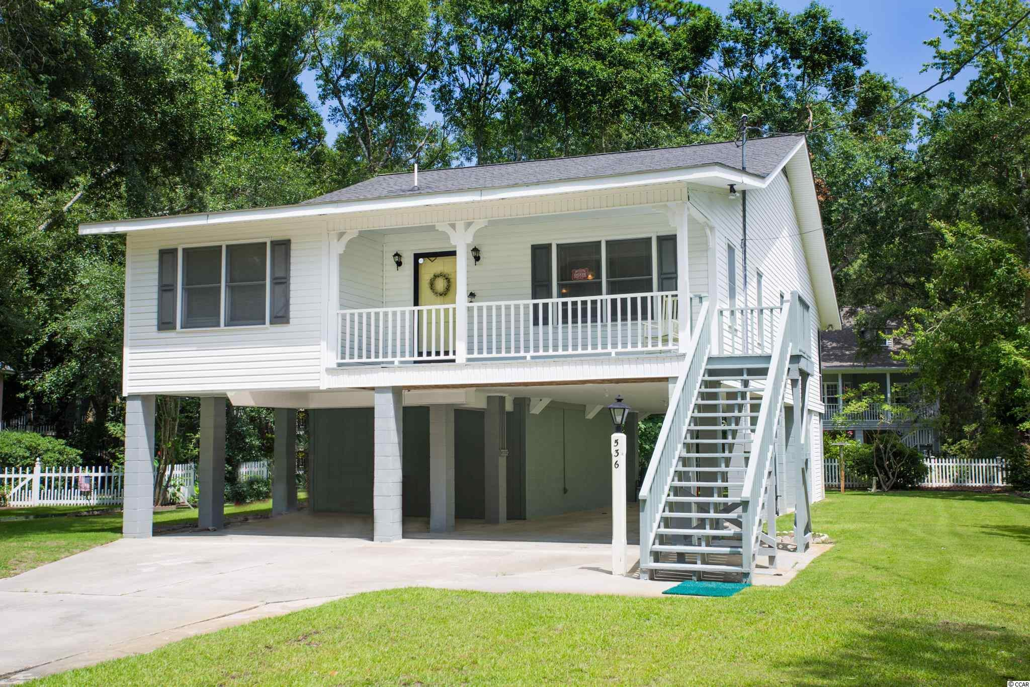 Very nice 3BR, 2BA raised beach house in beautiful North Litchfield.  Low HOA is optional but current owner pays it.  Features Hardwood Floors, Laminate, Linoleum and Vinyl.  Underground 4-car carport with elevator to upstairs.  Large master suite, master bath with Shower.  Two guest bedrooms share second bath with shower.  There is an outdoor shower underground perfect for washing the sand off after enjoying the beach.  Fully equipped kichen with Range, Refrigerator, Dishwasher and Garbage Disposal.  Washer and Dryer convey.  Gorgeous grounds and large front deck to enjoy the views.  Attic storage from front of house to back.  See today!!