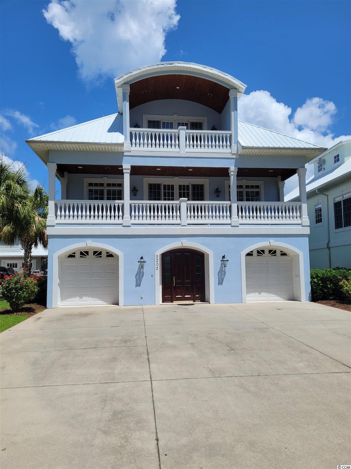 5BR / 4BA raised beach style home with peak view of ocean and community pool on quiet street with large beach access 5 min walk / 2 min golf cart ride away. Home features garage space and 2 bedrooms with full bath on ground floor / main floor has great room , kitchen, dining, 2 bedrooms and 2 baths / top floor is dedicated to master suite.