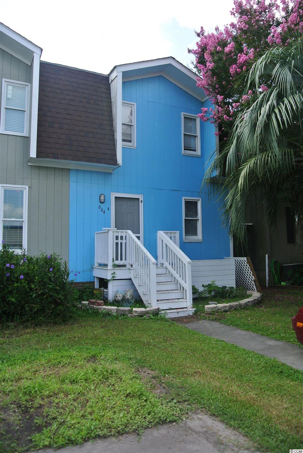 This is a rare opportunity to own a charming 3br/1.5bath true townhome located east of 17 in desirable Murrells Inlet just a couple of blocks to the beach. This is a two-story home with spacious living room with fireplace downstairs leading to a nice enclosed screened in back porch and fenced in courtyard. Upstairs you will find three cozy bedrooms. The home needs some TLC, but has newer roof, HVAC, and water heater. NO HOA FEES! This property is a great investment opportunity nestled in an amazing location minutes to the marshwalk, Inlet Square Mall and all the great shopping, fine dining, and entertainment the seafood capital of South Carolina has to offer. A must see!