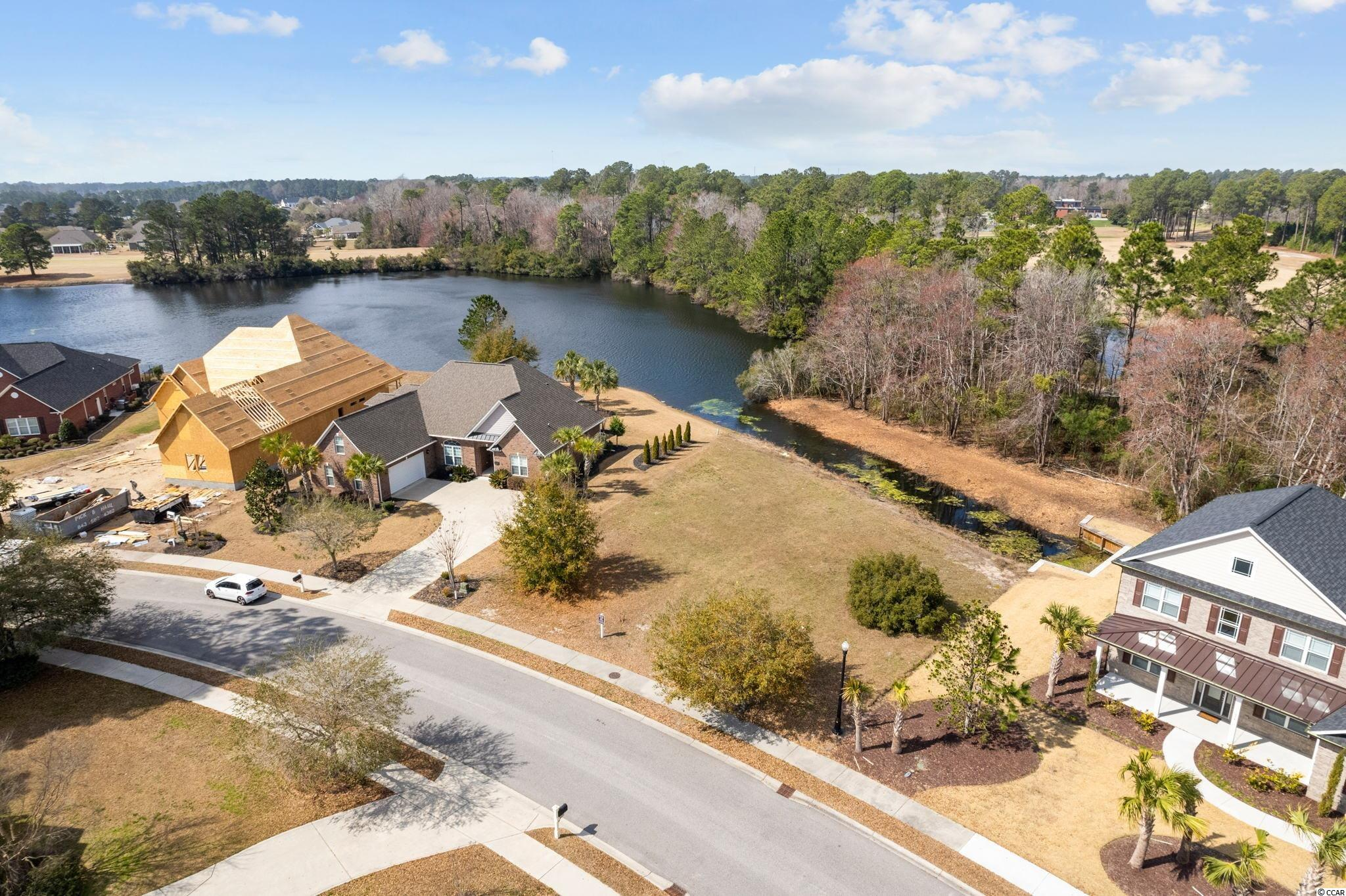 Don't miss this rare opportunity to own a secluded lake front lot or home in the prestigious luxury lake community of Wild Wing Plantation. This fabulous cleared flat lake front lot is located on a private cul-de-sac with secluded privacy, no neighbors behind, 180-degree lake view that offers breathtaking sunsets looking down the lake. This lot is now one of the lowest priced lots on the large 180-acre lake.  Lot #51 is nearly ½ acre and offers you 85' road frontage and 133' lake frontage. You can choose from multiple building plans or have your own custom-built home built on this lake lot. You can use your own builder or use our featured builder with no time frame to build. This home will have the latest state of the art green energy features and be SOLAR ready!!!    Enjoy the many SC lake birds, including blue heron, egrets and even eagles. Wild Wing Plantation has over 180 acres of lakes for you to explore and enjoy. You can even have your own private boat dock, use your boat to explore the lakes, fish and even take your boat to the clubhouse to also enjoy the many amenities there. The community features custom built brick and stucco style luxury homes.   Association amenities included large clubhouse, multiple outdoor pools, hot tub, 80' waterslide, tennis/pickle ball courts, basketball court, playground area, huge day dock, private boat ramp and owners private boat storage. Be sure to have your Realtor ask about the Wild Wing Golf Club membership promotion that the developer is offering!!! Wild Wing Plantation offers convenient easy access to Coastal Carolina University, shopping, the beaches and all that Myrtle Beach and Conway has to offer. House plan is for illustration purposes only. Seller will entertain home/land package. Survey with setbacks available upon request. Do NOT miss this opportunity on one of the lowest priced lake front lots available. And it's cleared and ready to build.