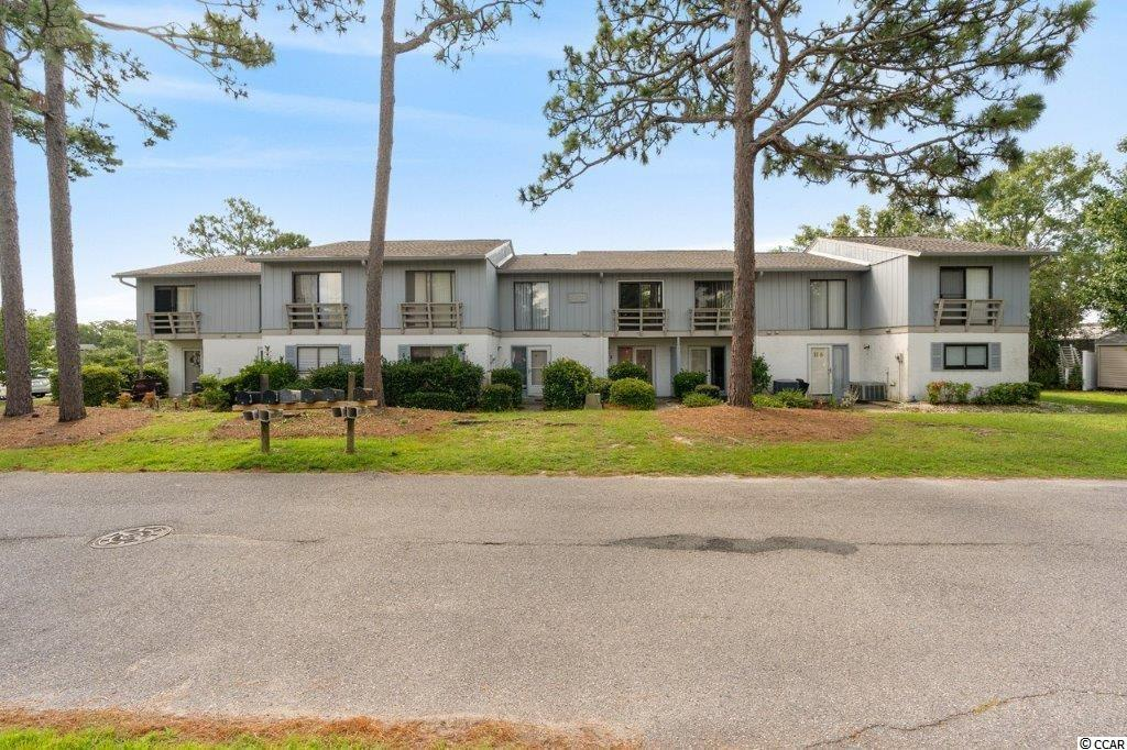 This amazing lakefront condo at Deer Track is a must-see! It has 3 bedrooms, 2 full baths, and 1 half bath. The master bedroom has a sliding glass door that leads onto a balcony and the living room has a very spacious patio area, both have a beautiful view overlooking the lake! This unit offers lots of space, is in a great area, and the HOA includes numerous amenities. The community pool, clubhouse, and activity center are just a few and all are just a short walk away. Quiet Surfside community just 1 mile to the beach and only minutes to all the area has to offer, shopping, dining, and all attractions. Perfect for a vacation place, or full-time residence.