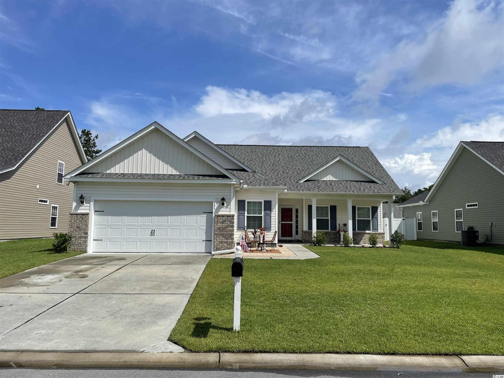 Looking for almost new construction that is move in ready? Here it is! This well maintained home is ready for a new owner! Built in 2017. Vaulted ceilings in the living room and tray ceiling in the master bedroom.  Master bath recently remodeled with an oversized soaking tub with hand held shower. Wood flooring though out living room, dining, foyer, halls and bedrooms. Upgraded vinyl tiles in the kitchen and baths. Custom paint and woodwork in living room. Upgraded kitchen sink. Super efficient natural gas dryer, gas stove, gas heating and gas water heater! Covered rear porch. Large yard with privacy fencing and irrigation. All of this and only 20 minutes from the beach and all that Myrtle Beach has to offer!
