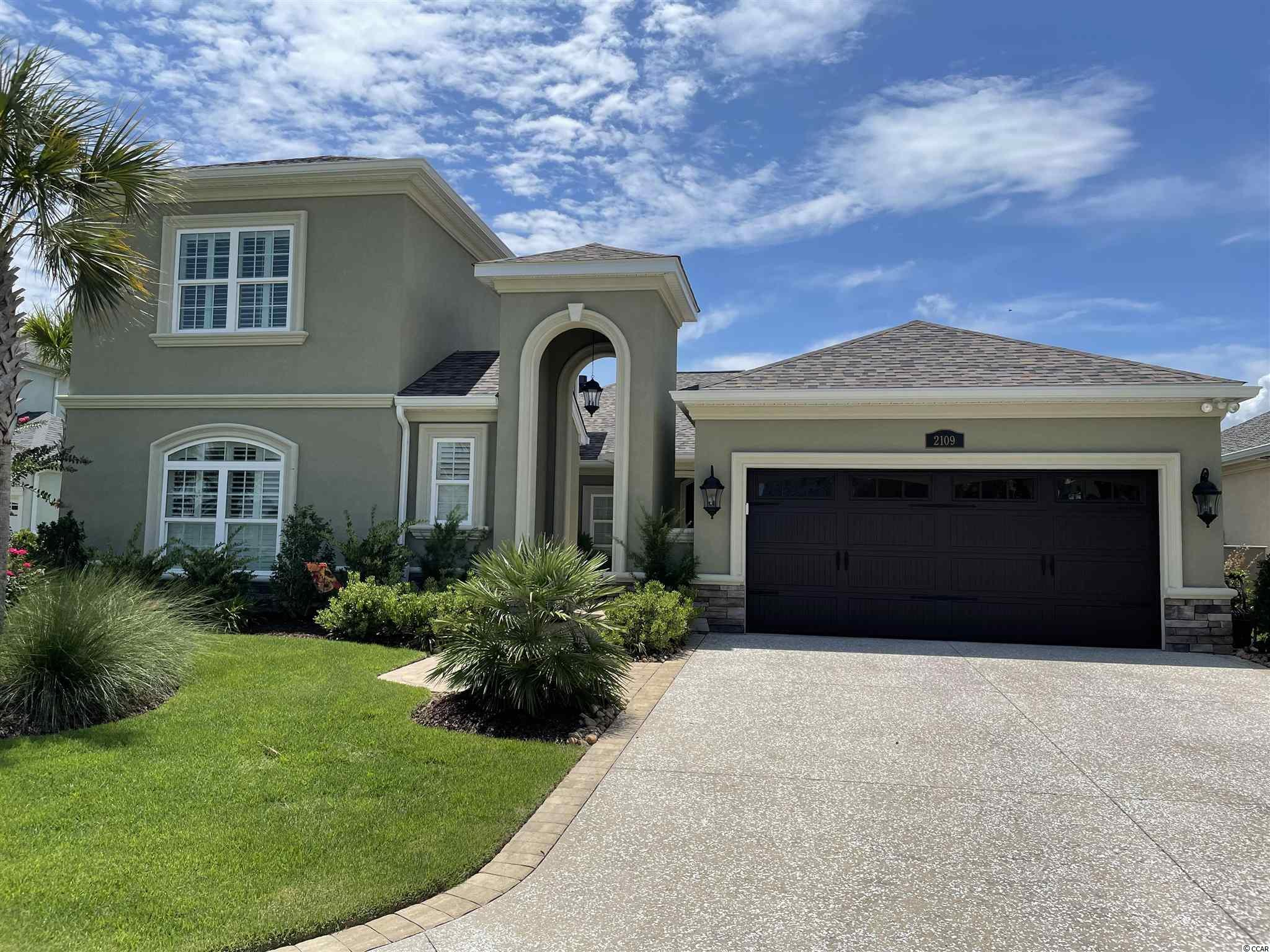 This beautiful, two-story Mediterranean style home is located in the popular Tuscan Sands subdivision at Barefoot Resort and Golf. Exterior details include a tower entry into a pavered courtyard with lush flower beds, rear covered and screened patio, and rear covered concrete patio-deck with pond views. This home has over 2,900 square feet of air conditioned living area and is just over 4,000 total square feet, thus providing a generous amount of open floor living space. From the kitchen's custom cabinetry and stainless steel appliances to the master suite and bath's double sinks, spacious garden tub, and luxurious walk-in shower, this house exudes quality craftsmanship. If you are looking for a house built with extra care and excruciating attention to detail, this is it. This home was custom built for the owners. They have been the sole occupiers of the house for the past two (2) years. They have installed the following upgrades: custom closet treatment in the master closet, custom cabinetry and desk in the office, custom shelving and sink in the garage, and a full home security system. Tuscan Sands has a prime location within the Resort. It is within walking distance of the Resort Clubhouse, driving range, and restaurants. You are also a little over a mile to the ocean and right across the Intracoastal from Barefoot Landing and all that the beach has to offer. You could not ask for a better place to call home. Don't miss out on this amazing opportunity to live in the lap of luxury at Barefoot Resort and Golf!