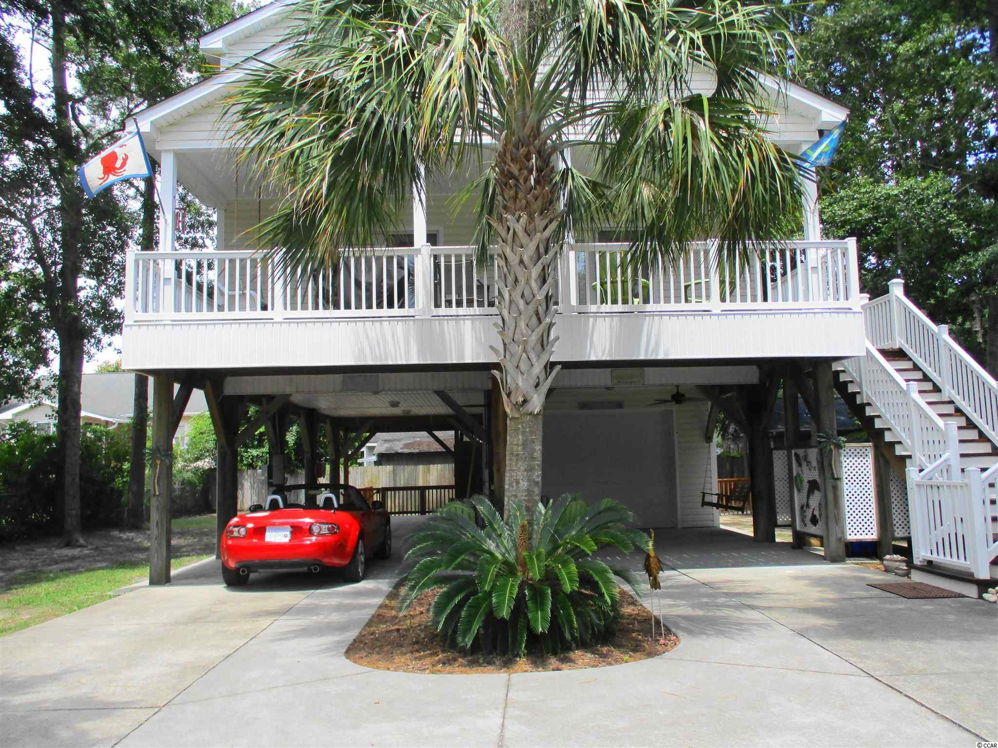 NO HOA. Walk thru this beautiful bright maintained completely furnished 4 bedroom 2 bath raised beach home with garage, patio furniture & swing. The covered deck is perfect for entertaining with table, chairs, swing & grill.  The high kitchen, dining and family ceiling provide plenty of light. Walk out the master bedroom onto a large deck, down the stairs to the fenced yard & outdoor beach shower. This home has many closets, plenty of parking space for guests, includes washer & dryer, furnishings, decorations, linens, cookware.  HVAC 2016, Water heater/upstairs 2019, refrigerator 2017, washer & dryer 2016, microwave 2019, Natural Cedar stain on decks 7/21. All bedrooms have ceiling fans. Owners used as 2nd home. Note: car & golf cart do not convey. Buyers responsible for accurate measurements.