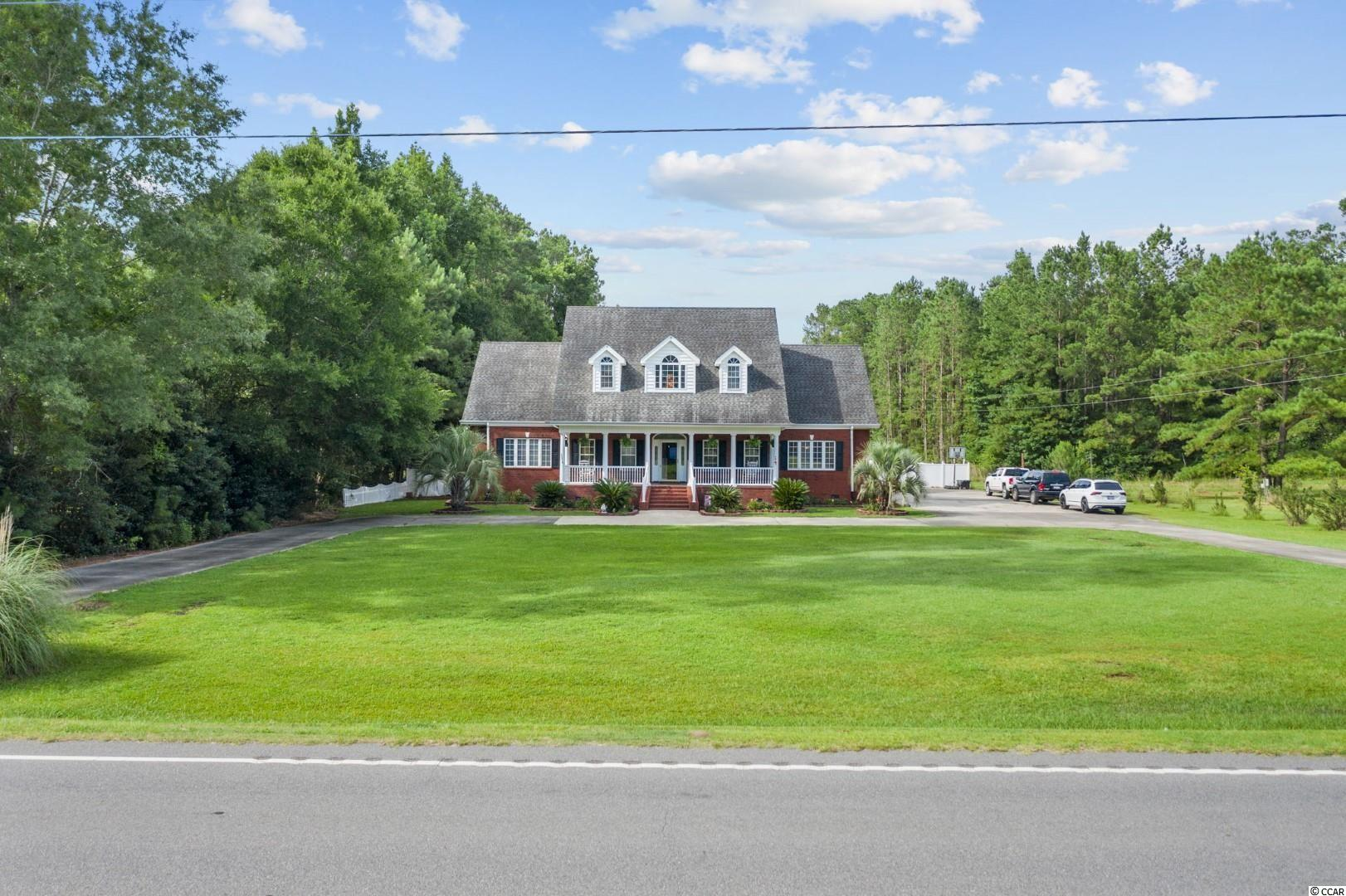 This custom all-brick home sits on 1.25 acres and is just a short drive from downtown Conway and all Myrtle Beach has to offer.  Featuring a large circle driveway and sprawling front porch, as you enter the home you are greeted by the bright foyer and beautiful hardwood floors. This leads to the massive living room with a brick fireplace. The recessed lighting draws attention to the built in entertainment and bookshelves. The eat-in kitchen has granite counters and stainless appliances, with solid cabinets and breakfast bar. The adjoining formal dining room is well appointed and comes fully furnished.   The first floor master suite has a spacious walk-in closet and huge master bath. The bath has bright lighting, tile floors, and both a soaker tub and shower.   On the first floor you'll find a second large bedroom, or huge office space, as well as a laundry room large enough for cabinetry, spare freezer, and more. As you head upstairs you'll find a split plan with 2 matching suites. Each large bedroom has a built-in desk, full bath, walk-in closet, and bonus room large enough for all of your storage needs! Currently one bedroom has an attached gym, and the other could be used as a playroom, movie room, or just temperature controlled storage. There's also a pull down set of stairs to access the floored attic.   As you pass through the breezeway the oversized garage has 10ft commercial doors. It's ideal for large vehicles or a boat, and with enough space left over for a workshop and additional storage. Above the garage is a huge bonus room that could easily be tied into the main upstairs hvac system. This space is great for relaxing or entertaining, and the slate pool table conveys.   Behind the home you have a massive deck and pool, perfect for relaxing while overlooking the fenced yard. With a spacious layout and custom features, and just a short drive to historic downtown Conway, you'll want to put this home at the top of your list!  Square footage is approximate an