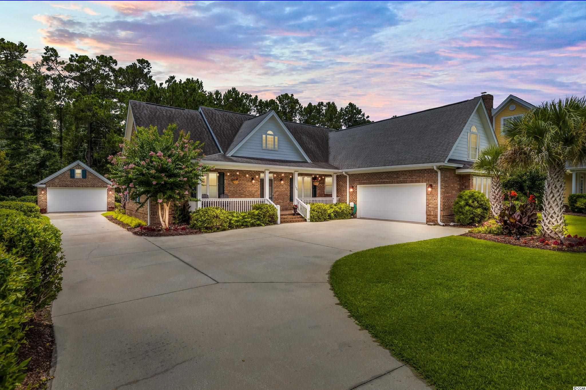 104 Hagar Brown Rd is a charming one story home, with a finished room above the garage, in Murrells Inlet. With four bedrooms and three full bathrooms, this home offers more than 2300 square feet of living space. This well maintained home showcases a large kitchen area overlooking the home's family room and dining area. The home also features vaulted ceilings, wood floors, and granite countertops, as well as an attached two car garage and detached two car garage. The main level hosts a private master suite and an impressive en suite bathroom with a large walk in closet. Two additional bedrooms and a full bathroom can also be found on the main level. The home's upper level features a spacious bedroom and a full bathroom. Don't miss this great find!