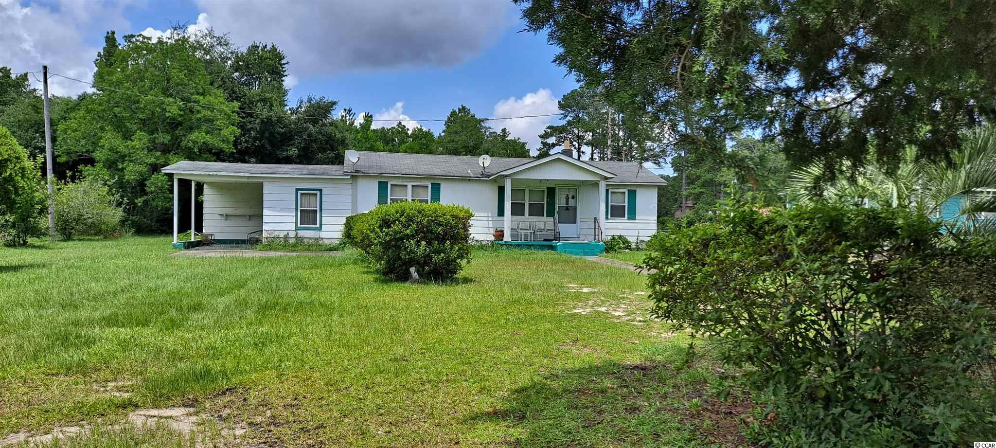 Three bedroom one bath on approximately one acre.  Needs work!  House is a fixer-upper. Square footage is approximate and not guaranteed. Buyer is responsible for verification.