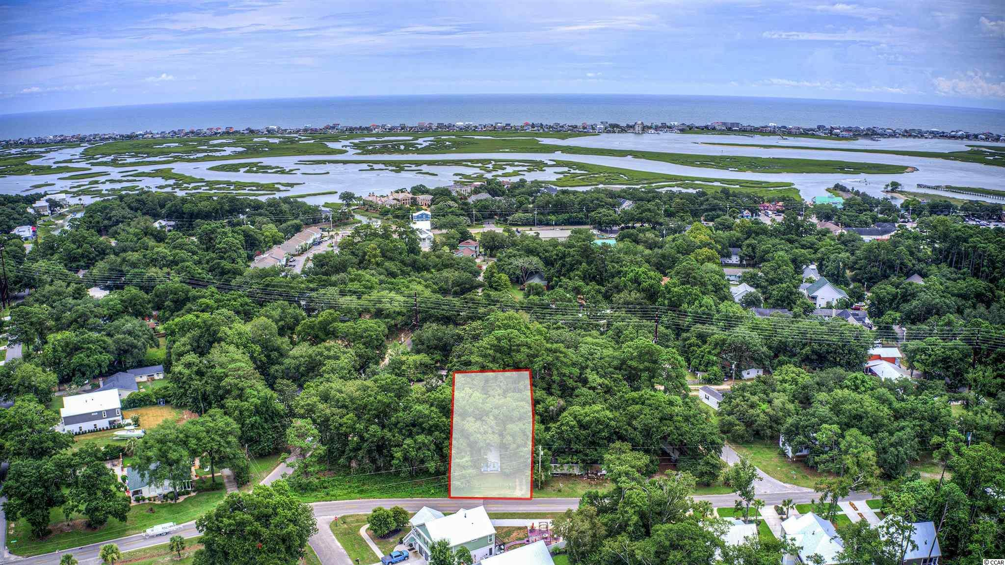 Here is your opportunity to purchase a property that is a hop, skip and a jump to the Marsh Walk, Morse Landing, Huntington Beach State Park, bike paths, and much more. You will NOT find another offering like this in Murrells Inlet Proper. The possibilities with this piece of land are extensive and only limited by one's vision. Perfect location for a primary home or a vacation property. Zoning is GR- General Residential and the total square footage of this lot is 7,380. One may even want to build an investment property here, either long term or short term. The choice is yours. Being Sold As Is.