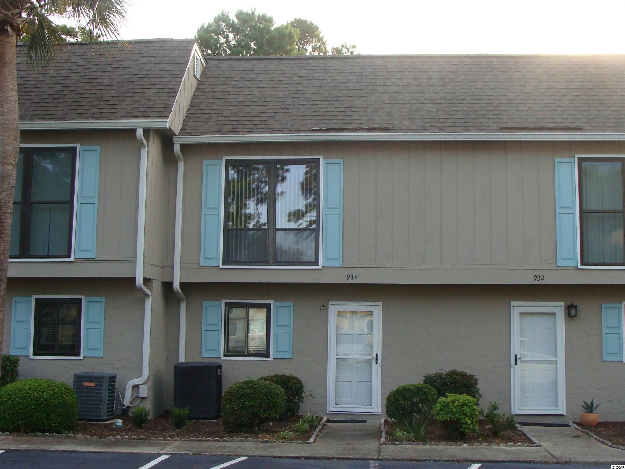 Great 2 Bedroom 2 1/2 Bath Townhouse in Robbers Roost.  Short walk or drive to the Ocean just down the end of 11th Ave. N. Convenient to shopping, restaurants and all the Myrtle Beach attractions.  Whether you're looking for a perminant or vacation home this unit is ready to move right in and make it your own.  First level kitchen, dining room, Living room, 1/2 bath, screen porch with laundry / storage closet.  Second level has 2 bedrooms each with 2 double closets and it's own bath. Robbers Roost offers it's property owns an outside pool, tennis court and Clubhouse with meeting room and bathrooms.  This area has limited golf car parking, there is a waiting list with no availability at this time.