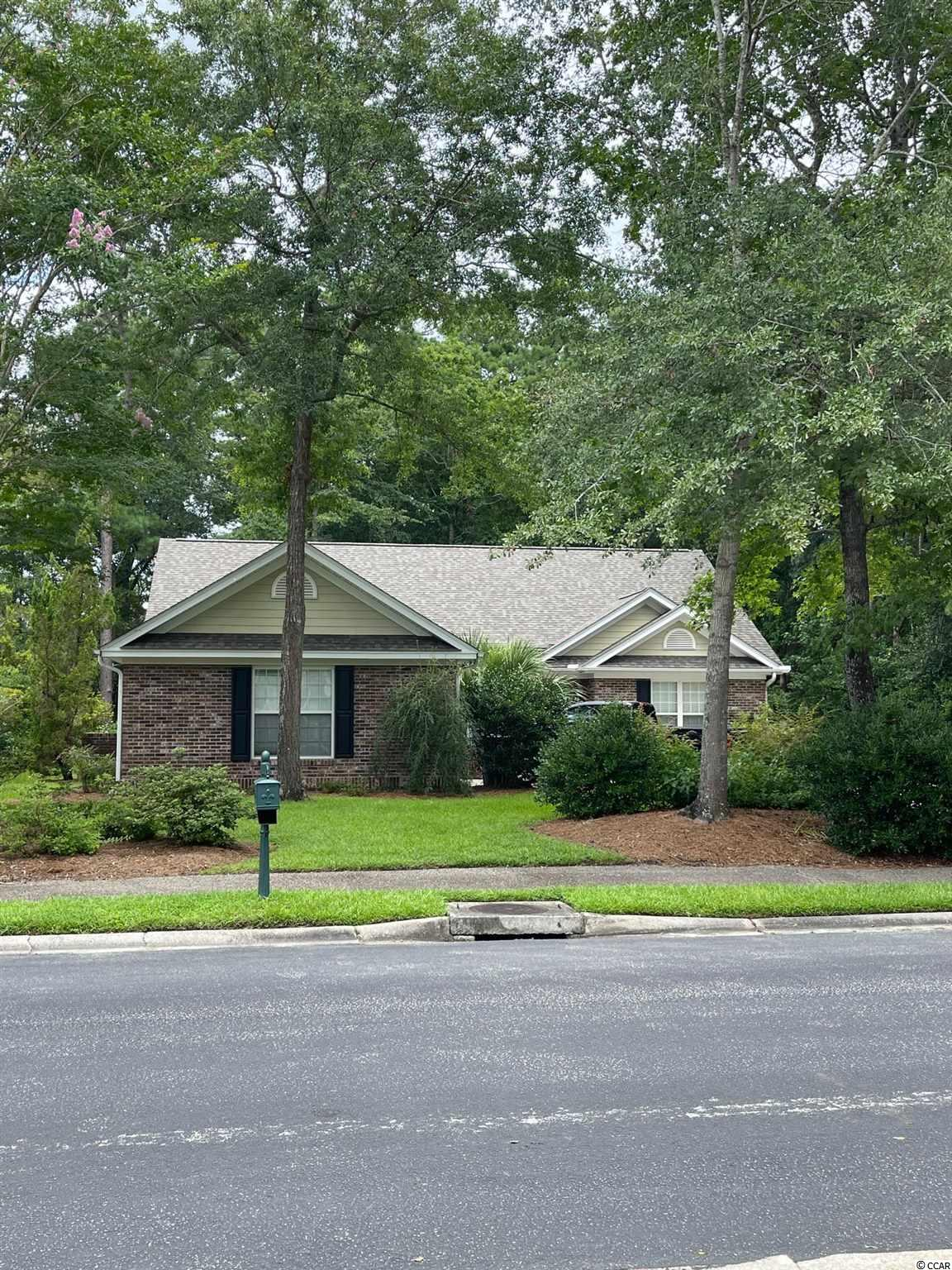 Spacious 3 bedroom/2 bath home located in Heritage Plantation.  Corner lot close to schools, shopping and beach.  This brick home located in Pawleys Island has a great open floor plan which features a large living room, screen porch and formal dining room.  Large bedrooms and two car garage make this a must see!