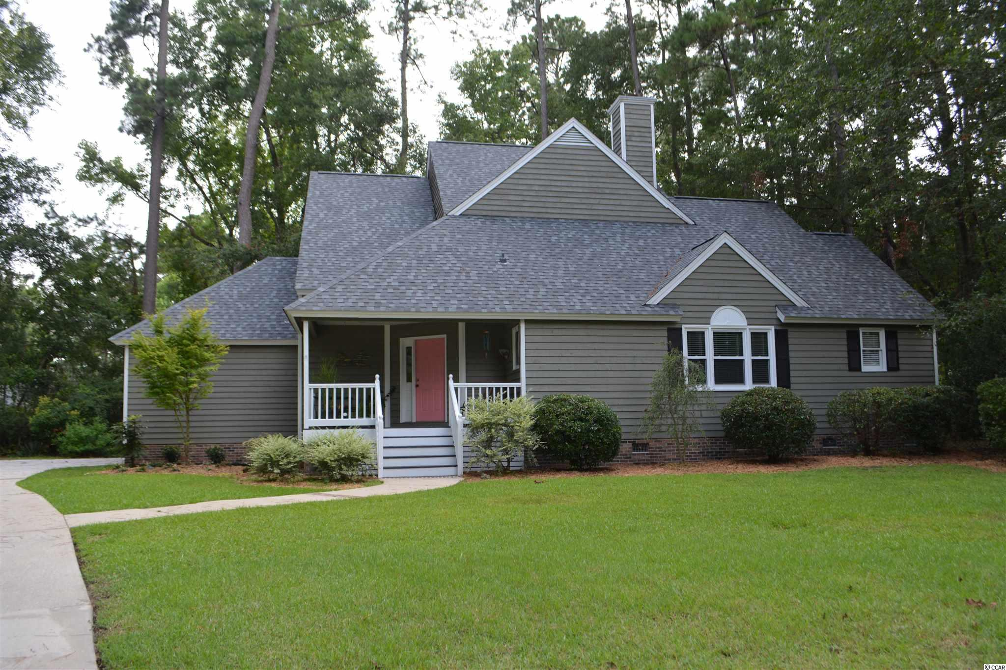 This charming low country home is located on a quiet cul-de-sac, in the sought after Ricefields Community and has a welcoming front porch. The floor to ceiling new windows span the back of the house overlooking the private, wooded large back yard. There is a renovated table space kitchen with a breakfast bar. The large, first floor owners suite opens into the cozy den and dining area. Upstairs are two generous bedrooms with a shared bath.  Ricefields also offers a community pool and boat landing.