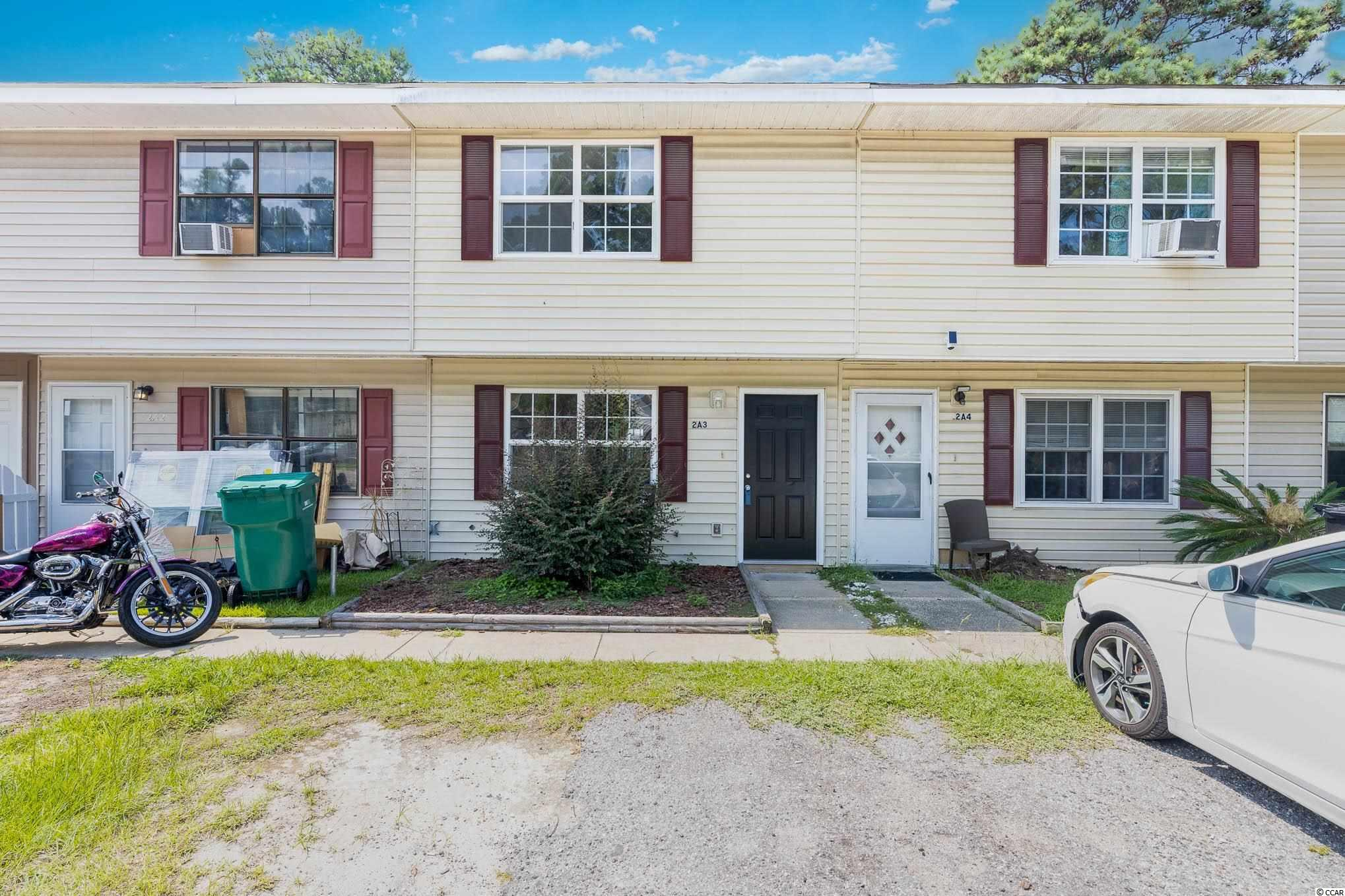 """Lovely NO HOA 2 bedroom, 1.5 bath townhome located in Deerfield plantation. Home has been freshly painted and includes a large living area, an overflow of natural light, tile and laminate flooring, kitchen appliances, washer and dryer, upgraded light fixtures, and a private balcony overlooking the private-fenced backyard. Roof replaced in 2018 and HVAC replaced in 2020. and  Located in Surfside Beach, also known as the """"Family Beach,"""" next to two great parks and less than 5 minutes from the beach."""