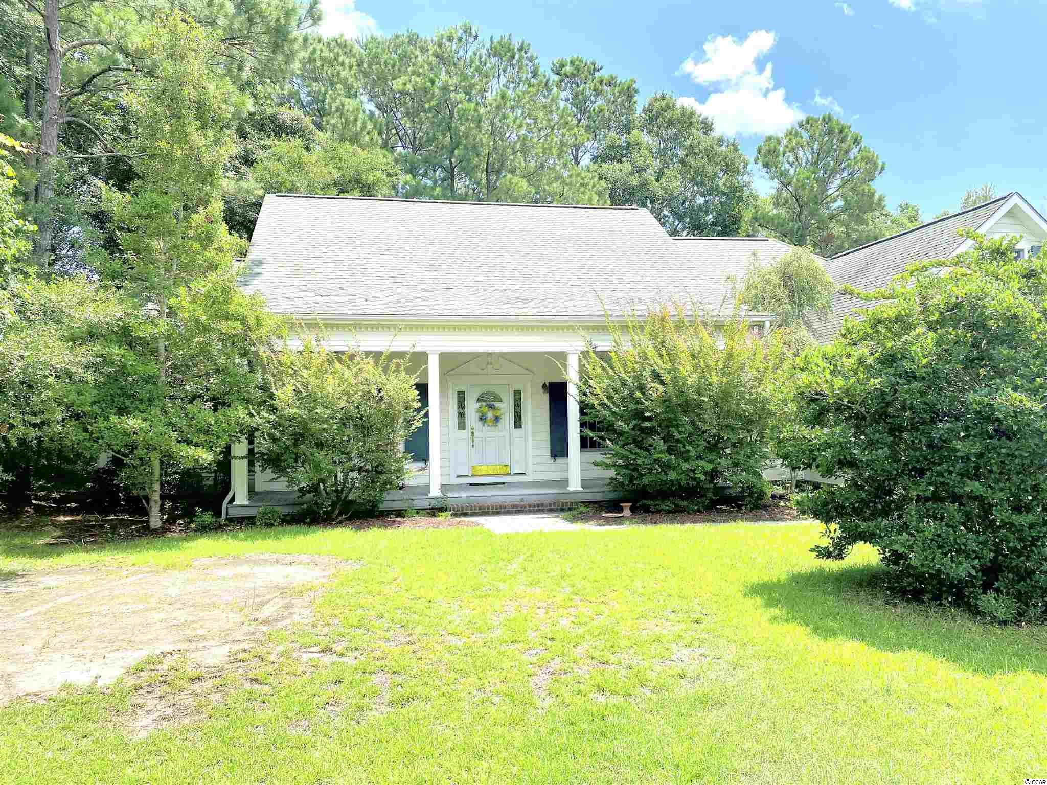 What a fantastic opportunity to own a custom built home east of 17 business in Pawleys Island, SC!!!  This is truly a must see!  This beautiful home features 3 bedroom/3 full bath home with a bonus room.  As you walk up to the front door you'll notice the perfect front porch with a lovely porch swing to sit outside with a nice cup of coffee in the mornings before you start your day, or with a bottle of wine at the end of the day.  Upon entering the front door you will find the formal dining room off to your right, perfect for hosting large family gatherings.  To the left of the foyer you will find the perfect room for a formal living room, or a TV room, or the perfect place for your office.  Just beyond the foyer you will see the fireplace in the family room, perfect for those chilly southern evenings.  This home features a split bedroom floor plan, so on the one side of the home you will find 2 guest bedrooms, one featuring an en-suite bathroom.  Both bedrooms are a generous size!!  There's plenty of room for the entire family!!  On the other side of the fireplace you will be welcomed by a spacious Carolina room.  Another room for entertaining friends and family!!! The kitchen is truly a chef's dream!!!  There's plenty of cabinet and counter space, a huge walk-in pantry to store all your cooking essentials!!  Down the hallway you will find the laundry room with a soaking sink, and access to the large 3 car garage.  Just beyond the laundry room you will find the enormous master suite!!!  This room is the perfect place to unwind from a long day at the beach.  The master bathroom features an oversized shower for 2, a jetted tub to take the perfect bubble bath!!  There's more!!!  Up the stairs just outside of the master bedroom, you will find a huge bonus room!  The possibilities for that room are endless!!!  In the bonus room you will find access to 2 walk-in attic spaces.  The amount of storage in this home is truly amazing!!!  This home is truly amazing!!!  It's a c