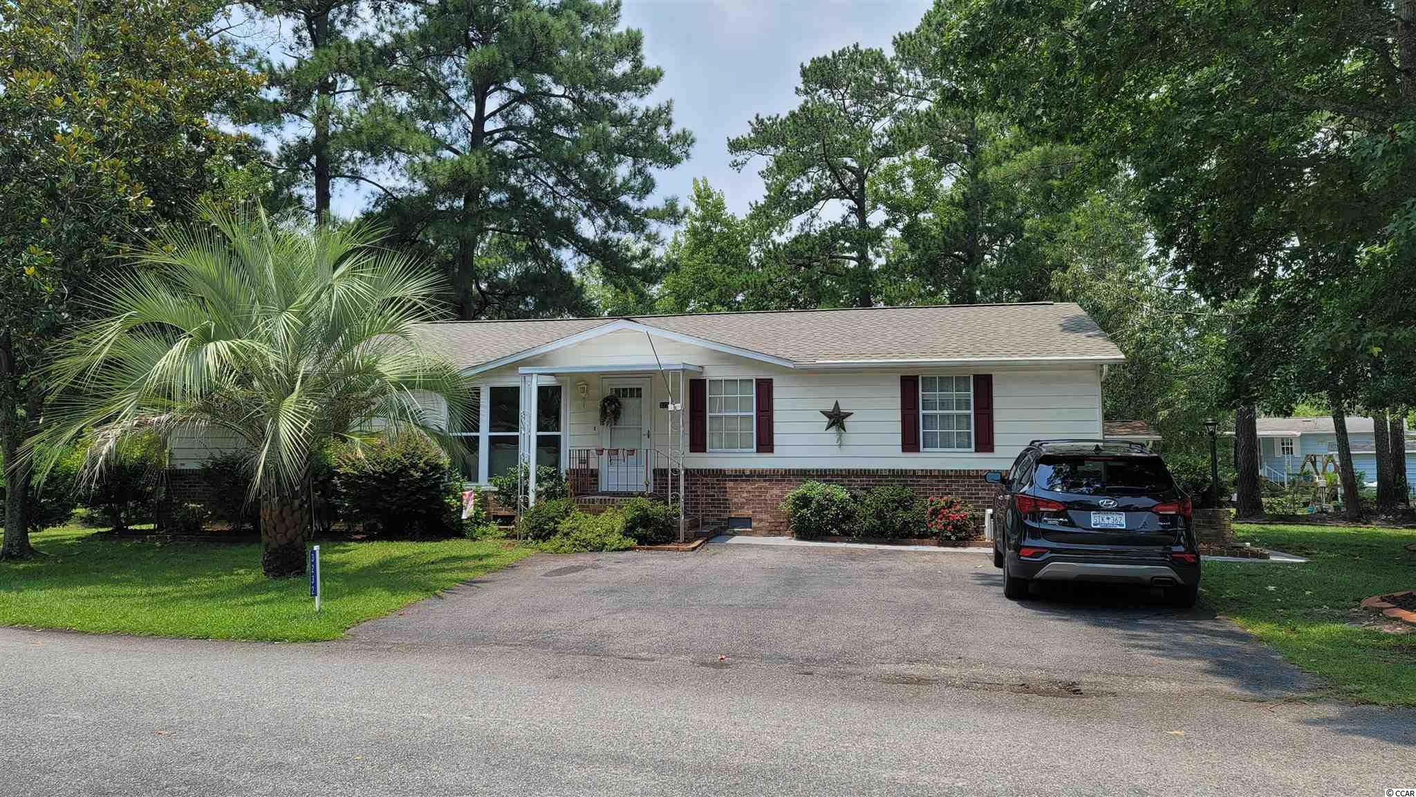 Beautiful home just a mile to the beach! Corner lot with lots of shade.  Open floor concept with a huge Carolina room.  Home is partially furnished and ready to move in.  Ocean Pines is a 55+ neighborhood with 2 pools, 2 club houses, library, work out room and game room.
