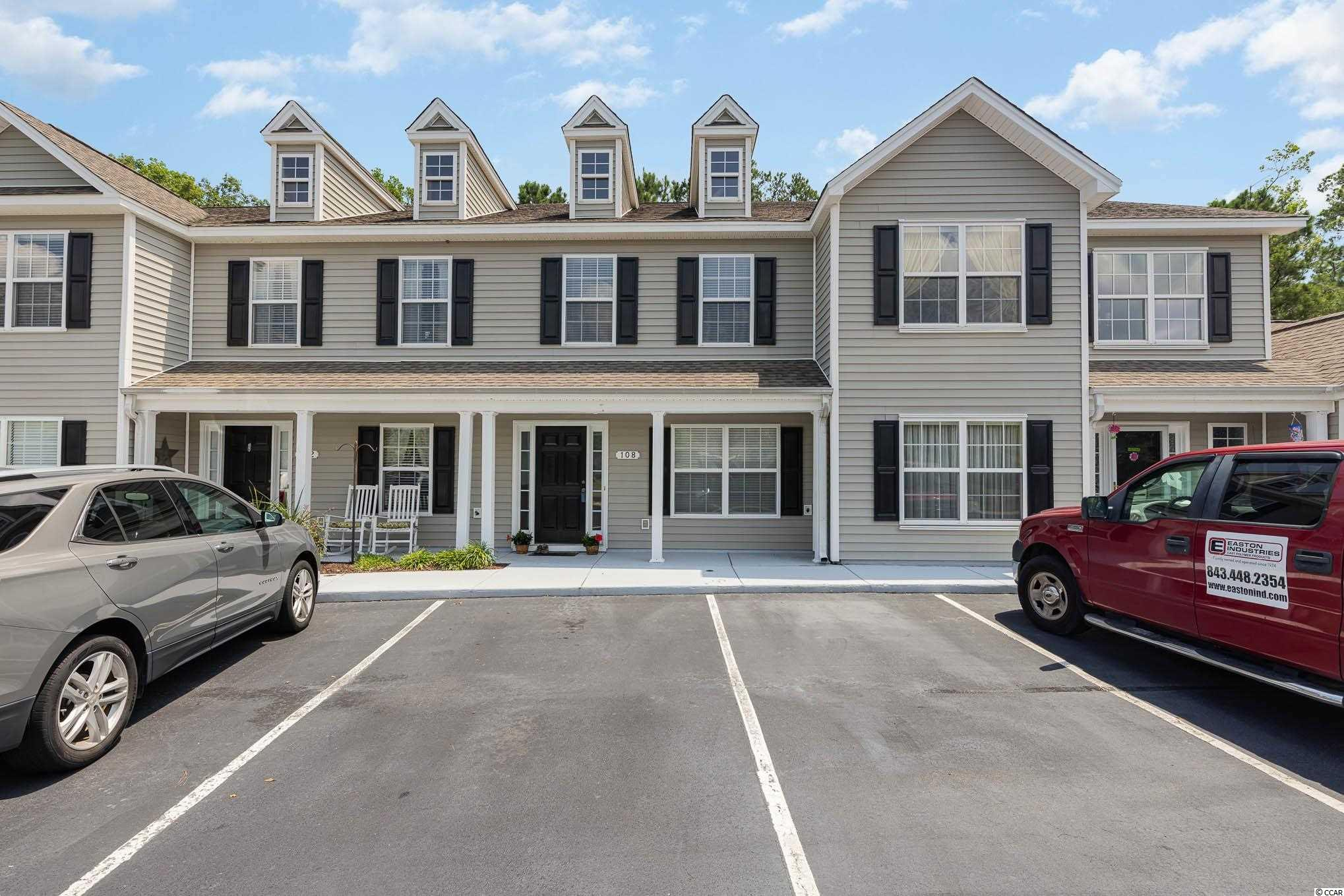 Located just minutes from beaches, shopping, and major access roads, this perfectly laid-out townhome is a gem!  On the first floor, you have a formal dining room, spacious open kitchen, and a living room with plenty of natural light from the sliding glass doors that lead out to your private screened in porch. A half-bathroom downstairs is convenient for guests, and upstairs you have two bedrooms that boast en-suite bathrooms.  The largest of the two bedrooms has dual closets and an en-suite bathroom with a double-sink vanity and garden tub. Upstairs laundry, additional outside storage, and assigned parking are just some of the features this townhome has to offer! Come take a look today!