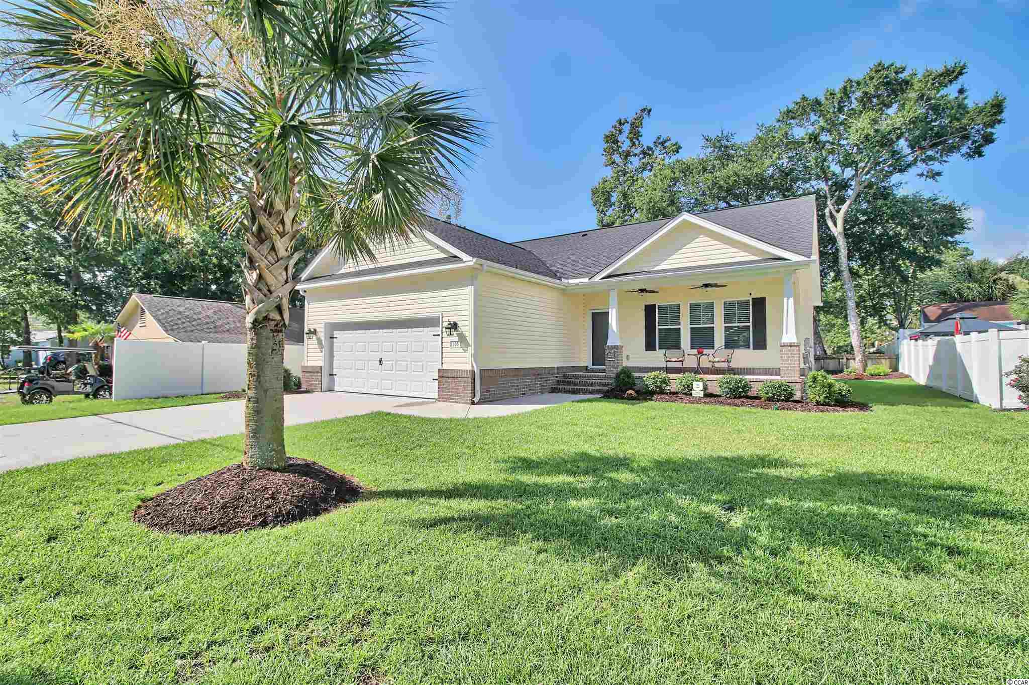 What a find!!! Almost new home built in 2016 and only used occasionally as a 2nd home located only 2 1/2 blocks to Surfside Beach!!! Open the front door to a welcoming open-floor concept living room, dining room, and kitchen with cathedral ceilings and engineered hardwood floors. 3 Bedrooms, 2 Baths with 9 foot ceilings in them and in the hallway, with a tray ceiling in the Master Bedroom. Granite countertops in both the kitchen and the baths, tile blacksplash in the kitchen with Stainless Steel appliances. Ceramic tile floors in the baths and laundry area. Epoxy garage floor with cabinetry and a 12,000 BTU mini-split (with heat), rear screened porch and irrigation system on a separate water meter.