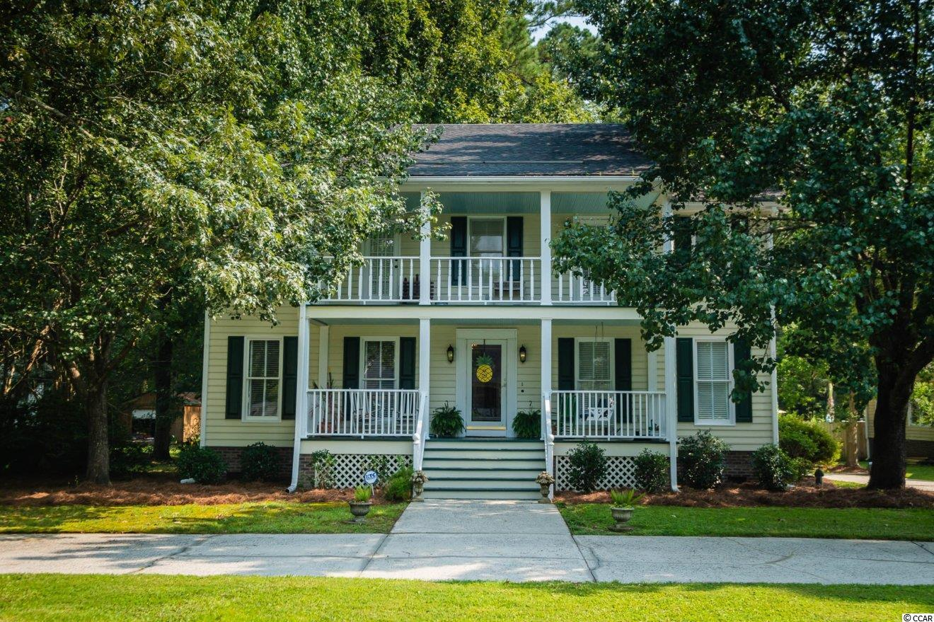 """Absolutely Charming Lowcountry/Charleston Style Home located just a short drive from Historic Downtown Conway SC. This home is located in the Coveted Sherwood Forest Neighborhood which boasts large homesites with mature trees and beautiful custom homes. A large circle drive welcomes you to two beautifully stacked balconies which encourage that """"Slow Down"""" lifestyle to appreciate almost an acre of the low country's finest property!!!  Inside the home you are escorted over Hardwood and engineered hardwood flooring on the first floor with a Formal Sitting Room, Formal Dining, Large Family Room, and Kitchen with rear entry to the back porch!! Upstairs hosts the Master Bedroom and Bath, Master has access to the front 2nd floor balcony. Two more bedrooms, a guest bath, and an extended room off of the Master Bedroom which could be used as a large walk in closet or could be converted to a 4th bedroom very easily.  The circle drive is complimented by and additional extension to the drive on the right side of the home which could easily accommodate a boat or RV. The expansive back yard has additional outdoor storage with plenty of room for more as the rear lot line is nearly 350ft behind the home!!!  All of this while being located just a short drive to all area beaches, shopping, and dining. Do not hesitate!!! Homes like this do not last long!!!"""
