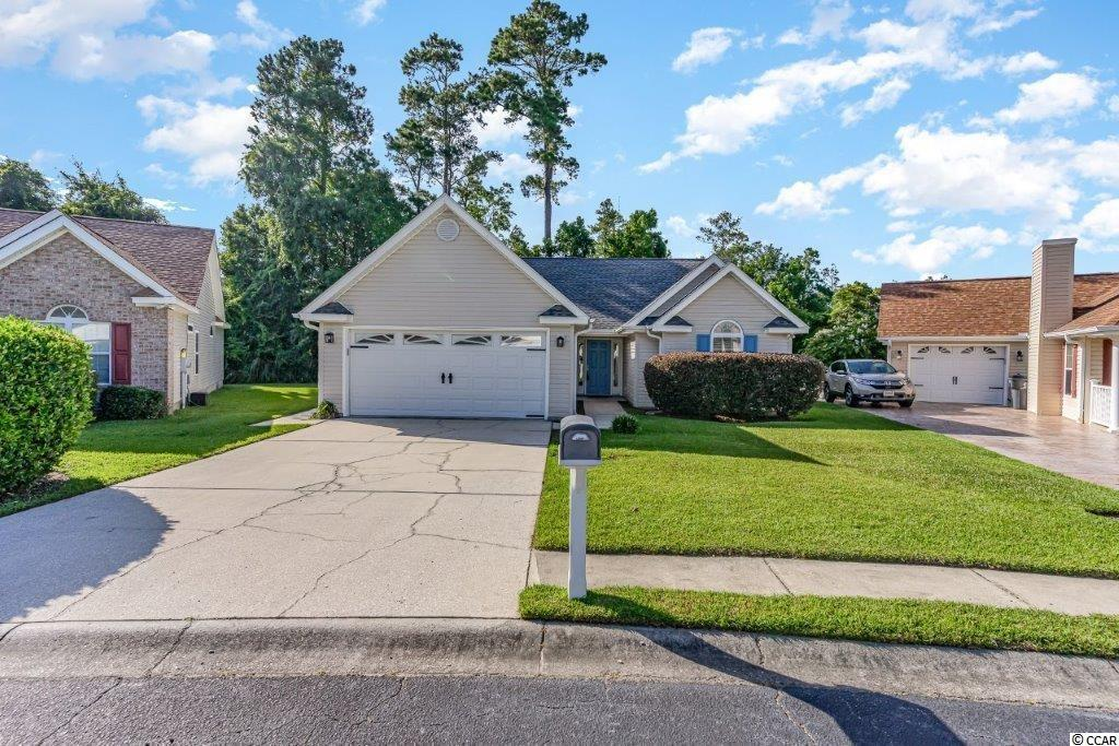 Don't miss this lovely 3 bed 2 bath  home located in the popular Summer Lakes community! Features abound in this delightful home and include vaulted ceilings throughout, ceiling fans in the living room and all bedrooms , laminate flooring in the living room and master bedroom, new tile flooring  in both bathrooms, new carpeting in the second and third bedrooms   and a new roof was installed in 2019  and new HVAC in 2015.  Wonderful open floor plan boasts a spacious living room and dining area perfect for more formal affairs that is adjacent to the fantastic kitchen with tile floors ,stainless appliances , abundant cabinet and counter space, a built in desk for meal planning, a breakfast bar, double sink and a large breakfast nook with room for everyone to gather.    The  private master suite features a walk in closet and  bath with double sink vanity, a garden tub and separate shower. The additional two bedrooms are nice sized with plenty of closet space and there is a second bath with vanity and tub/shower. Outside, the expansive patio just off the living room has plenty of room for grilling and dining and your kids will love all the backyard space.  The home also has a two car garage and an extended driveway with ample room for guest parking . Located in an award winning school district,  Summer Lakes is a quiet, established community tucked away from the hustle and bustle but just minutes from shopping, fine dining, The Marsh Walk, golf, public  fishing piers, Brookgreen Gardens, attractions and entertainment and ,  best of all, the beach !  Whether you are searching for a primary home or the perfect vacation getaway, this is  must see! Make an appointment to view this beautiful home today!