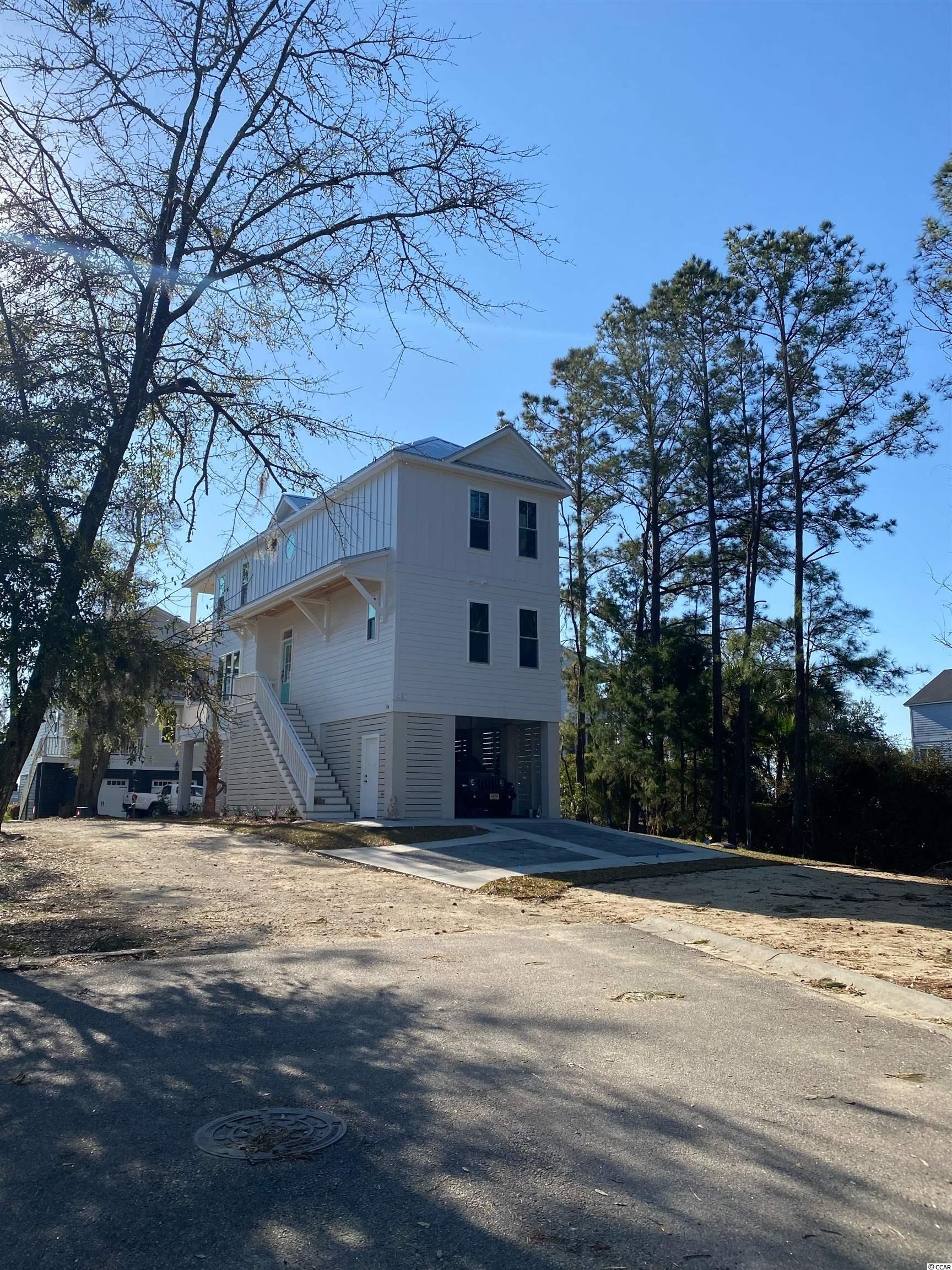 Wonderful home plan just breaking ground on Lot 36 in Marshland Park.  This home has everything you are looking for.  Pictures are of a very similar model.  This home will finish up late summer.  Hardie siding, metal roof, custom cabinets, LVP flooring, solid surface counters, etc.  Trash pickup and lawn maintenance included in the HOA.  Call today!
