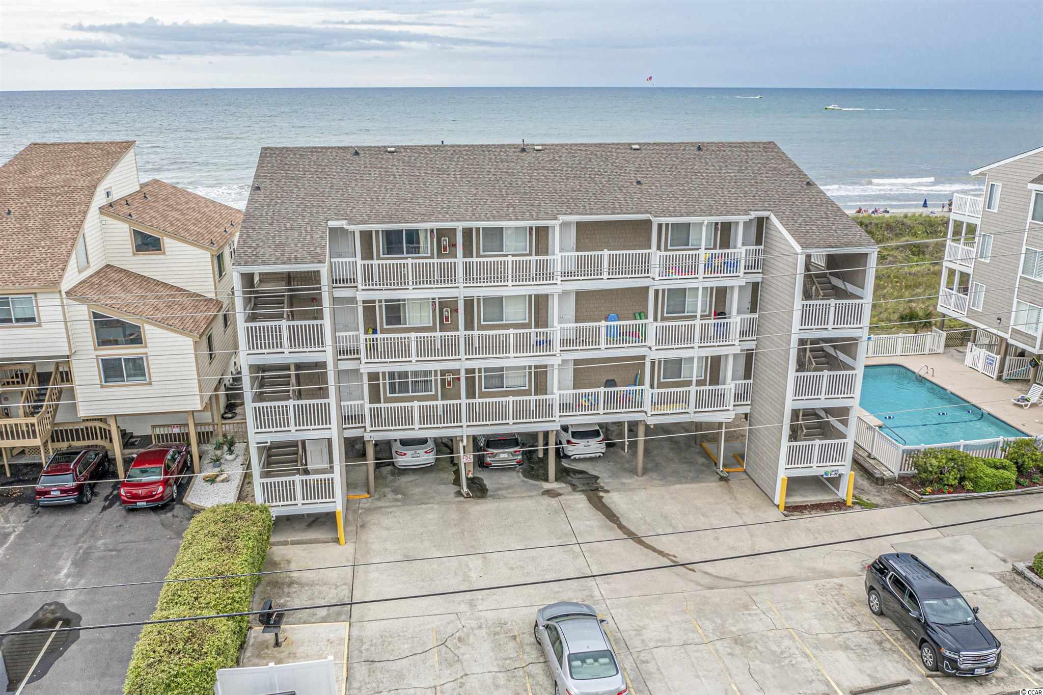 This is the one! This first floor, end unit has breathtaking views of the ocean. Located in the highly desirable Raintree Villas in Cherry Grove, this 2 bedroom, 2 bath condo is being sold fully furnished. This unit has never been rented and well taken care of over the years. This is one unit of 9 total in the building. Enjoy afternoons in the pool or bring your beach chair and umbrella and make a day at the beach! New HVAC in 2020. Low inclusive monthly HOA. Pack your bags and get ready to live the beach life!