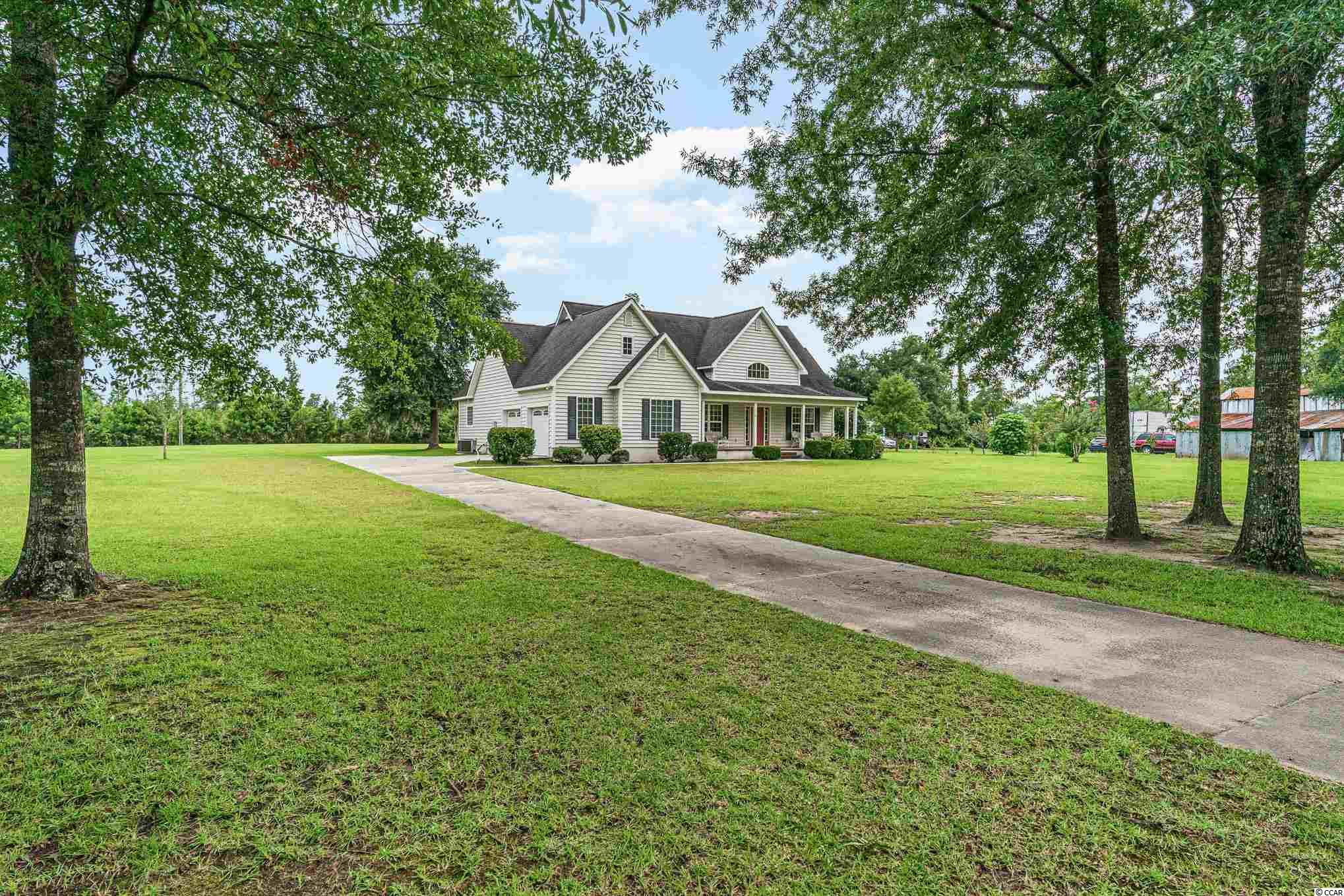 Peace and tranquility is what you will find when you drive up to 75 Fiddlers Loop. This beautiful move in ready, immaculate home, will not be available for long!  It has it all including a large front and back porch to sit, relax, and enjoy a tall cold sweet tea while enjoying all the nature on this 1 acre lot.  The home was only used as a getaway weekend home.  It has a deeded water access, so you can take your boat out, fish on the dock, or just sit and relax in the gazebo all while taking in the phenomenal scenery.   Vaulted ceilings give the home a wonderful open feel!  A spacious bonus room is located above the garage giving even more space to this spacious home.  Don't delay, you will want to see this beauty today!