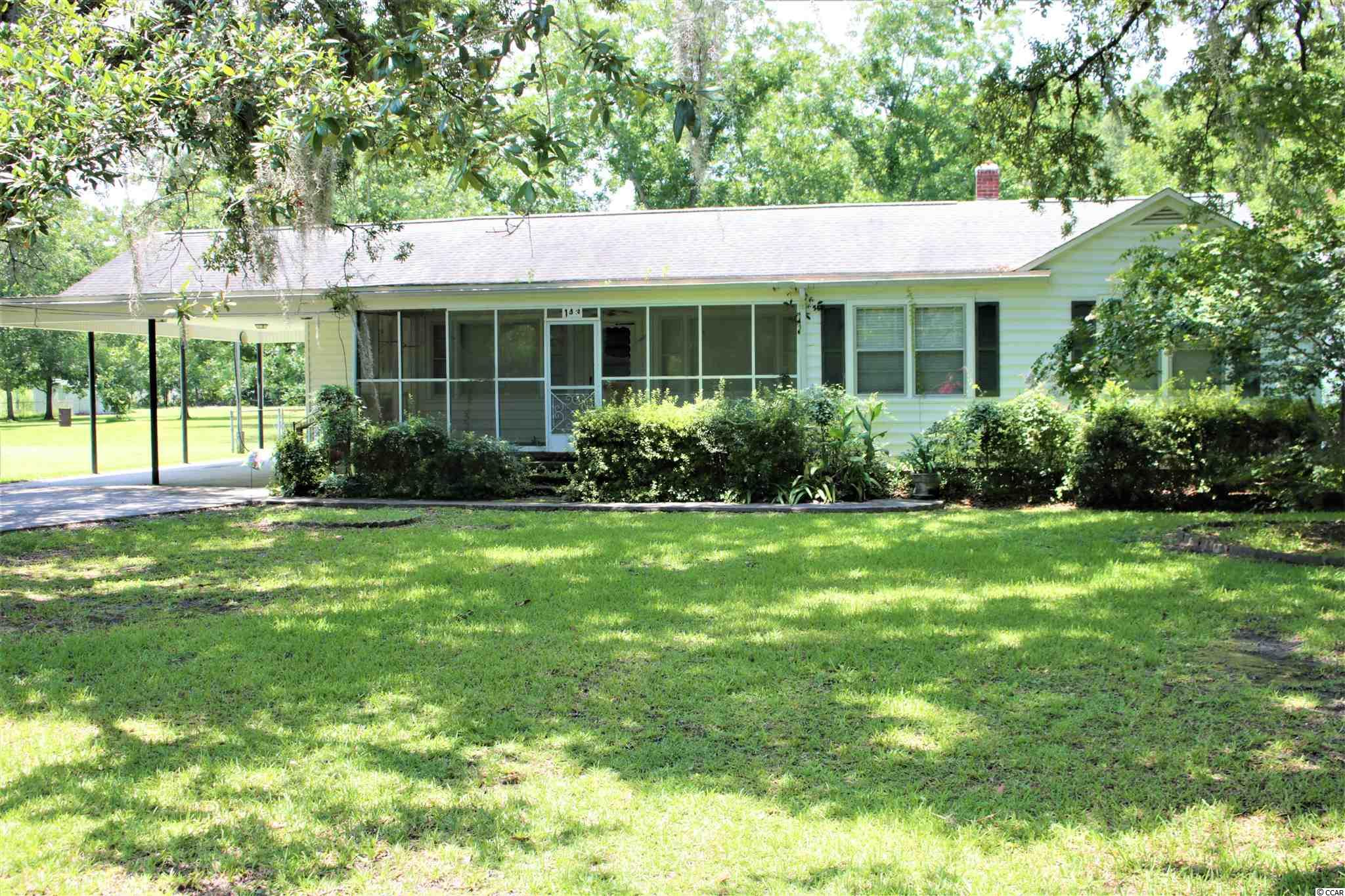 Nice 3 bed 2 bath home. Great location just outside of the city. Features include hardwood floors with large bedrooms with a carport and detached garage on a .67 acre lot. More pitchure to come.