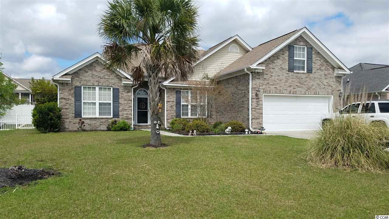 Have you been searching for your own piece of paradise at the beach? Well, here it is. This turn-key, move in ready 4 bedroom, 3 bathroom home has every one of your desires. Located a short distance from Garden City/ Surfside Beach, and, an even shorter distance to Waterfront Murrells Inlet. The home has an open concept with vaulted ceilings in nearly every room. Very nice updated LVT flooring , AND, brand new heat pump installed last year (2019). The 4th bedroom is upstairs, over the garage and features it's own full bathroom. Once you have fell in love inside, step outside where the real fun begins. Just off your back patio is a 12x24 salt water pool and a fenced in oasis. Very nice pool deck with plenty of room for all those Summer parties. This a a very peaceful neighborhood.