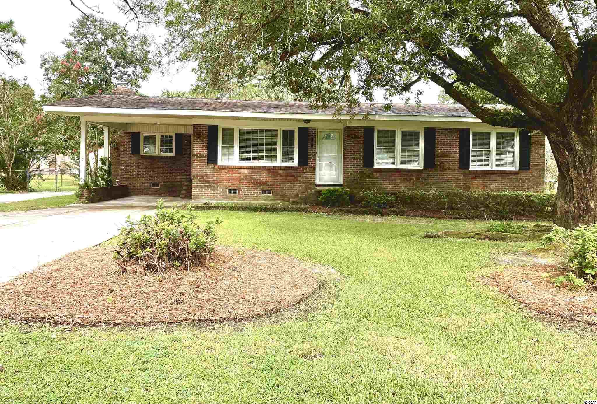 Nice brick home with fenced in backyard!  Hardwood floors throughout except in the kitchen and bathrooms. Large kitchen with updated cabinets and countertops.   No HOA!  Plenty of parking for a boat or RV.