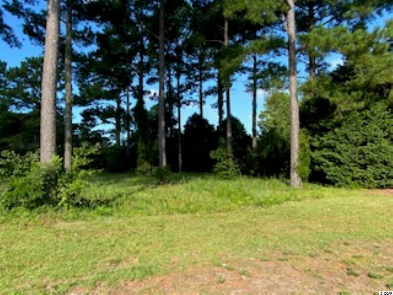"""Beautiful """"Over the Bridge"""" corner lot situated close to the entrance/exit in Grande Dunes. The back of the lot overlooks a beautiful manicured pond and the Resort Golf Course. Lot is situated on a corner with lots of common ground landscaping at the side and back of the lot, which makes this lot very special and private. The front view is gorgeous as it has unique common area landscaping on the half-moon Sedona Circle. This lot is located in South Carolina's premier coastal community in Myrtle Beach; Grand Dunes. Owners at Grand Dunes enjoy a 25,000 square foot Ocean Club that boasts exquisite dining, oceanfront pools with food and beverage service, along with meeting rooms and fun activities.  There are two 18-hole golf courses along with several on-sight restaurants, deep water marina, Har-tru tennis facility, and miles of biking/walking. This is one of the few choice lots left, over the bridge."""