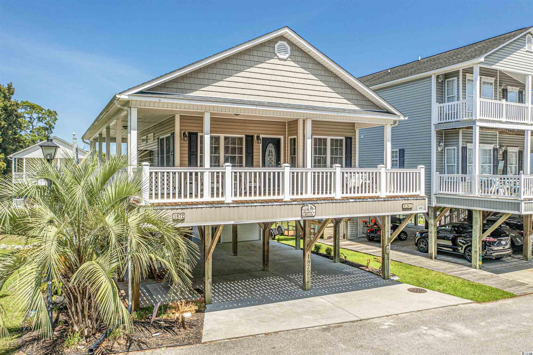 Stunning and IMMACULATE 3/2 stick built, stilt house on the swash!  Plenty of parking under the house, situated on a dead end with extra parking, side and  rear yard with steps to the swash.
