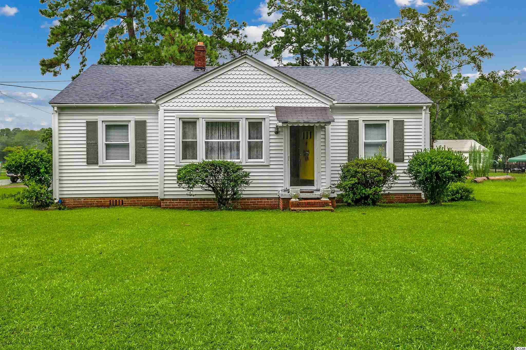 Cute cottage on corner lot! This mid-century cottage has original refinished woods floors to give it that perfect cozy feeling. Nice size front and back yard, 3 bedrooms, 1 1/2 bath, comes with carport and 2 sheds. Close to historic downtown Georgetown and only 20 minutes to Pawleys Island.