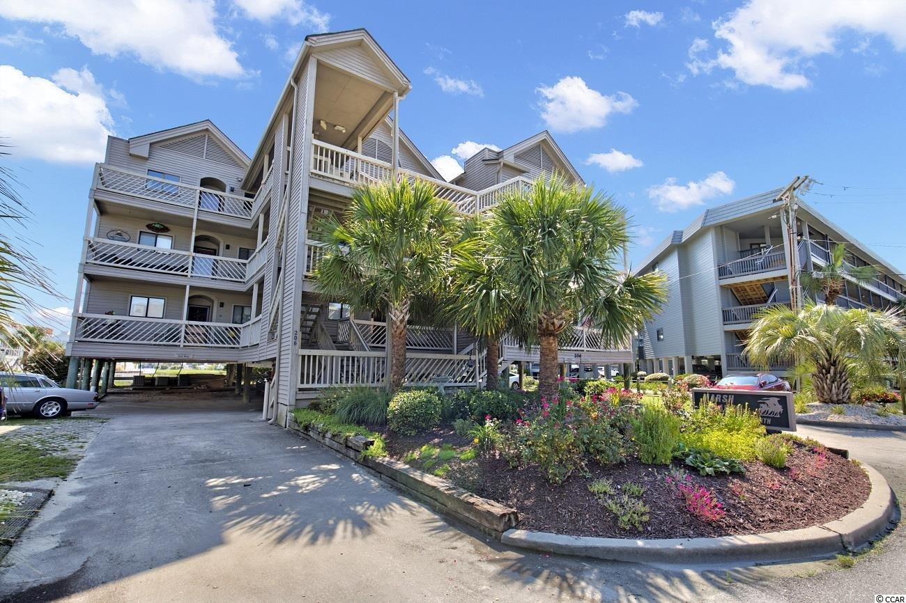 """This 2 bedroom 2 bathroom unit has spectacular views of the marsh, Cherry Grove, and the ocean.  Located near the most northern end of Cherry Grove, it offers the quiet and quant that is everything Cherry Grove.  This unit is walking distance to the ocean out of the front and a mere steps to crabbing out the back. New water heater is in place, furnished and a big front and back porch areas that are great for relaxing.  Marsh Haven properties do not hit the market very often and will be popular. 2x6 construction on 16"""" centers with R19 insulation and hurricane resistant threaded rods extending from the top floor through the laminated beams below the first floor. Pilings supporting the building extend an average of 50 feet below ground. This is an extremely well-built and secure building. New architectural shingle roof in 2019 Siding replaced with Hardiplank on both sides of the building in 2019. Front and back siding replacement with matching Hardiplank will take place during the Fall (September/October) of 2021 to match the sides. This has already been funded. Replacement will start on the top floor and move downward. Panoramic views of channel and marsh."""