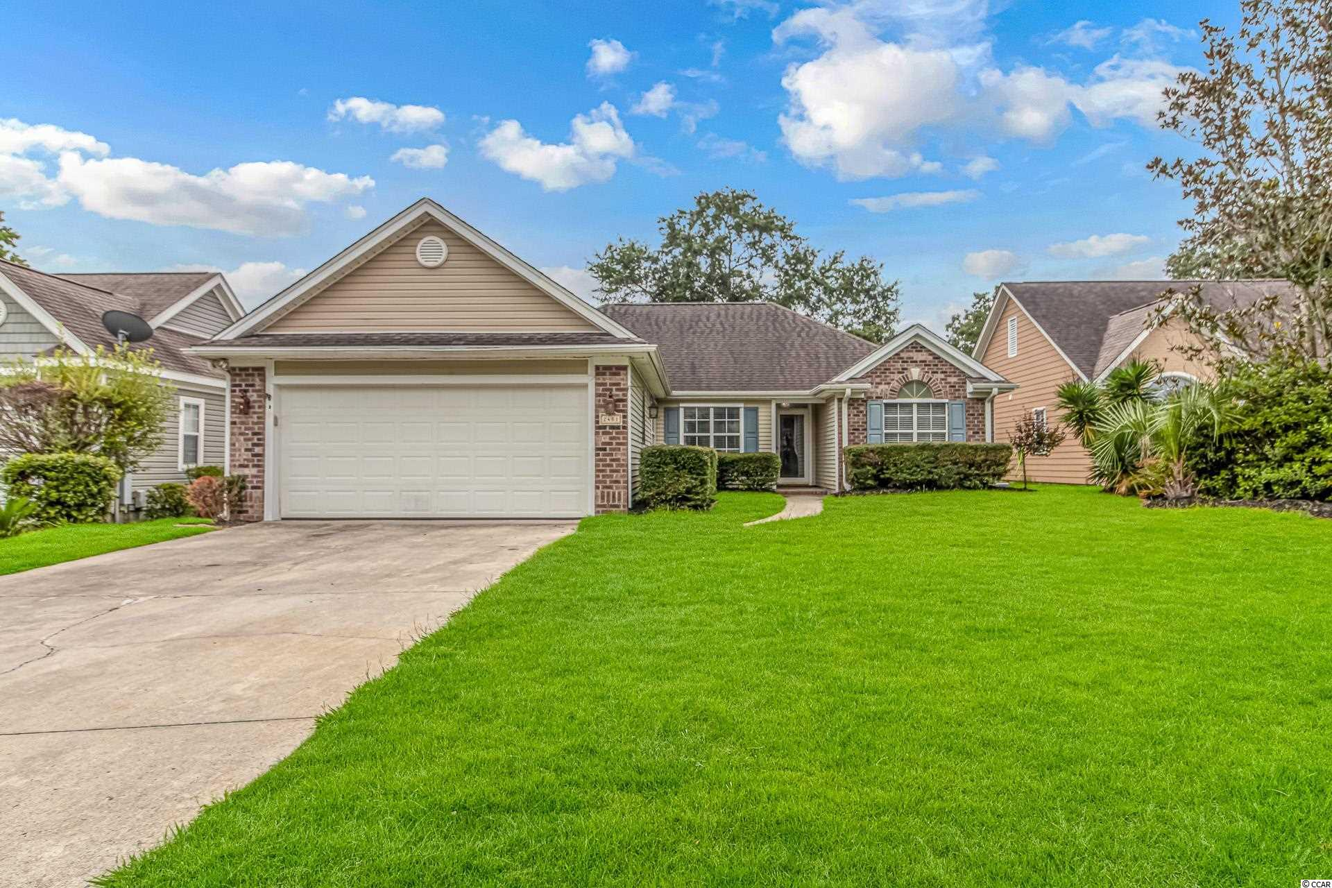 Welcome to the beautiful neighborhood of Heather Lakes. This mature, established community offers a club house, community pool, play ground and plenty of nature trails and ponds. When approaching the home, you will notice the Storm Door located on the front entrance. This feature is perfect for heavy storms, keeping the outside from coming in on beautiful days and perfect for more natural light. When entering you are pleasantly surprised by the complete openness of the main living area, with architectural beams, columns and cut-outs creating a separation between the living room, formal dining area and Carolina Room. Tile throughout the whole main living area, allows for easy cleaning, and with fresh paint on the interior walls creates this open airy feel. Right off the living room is large Carolina Room, with beautiful panoramic windows wrapping the whole space. The Kitchen is located to left, equipped with LVP Hard wood flooring, eat in dining area, breakfast bar, plenty of storage, all white appliances, white cabinetry, large pantry, access to the two car garage and the full sized laundry room. The second doorway off the living area to the left is the master bedroom/owners suite. This room features a built-in headboard, with lamps that turn on with just a touch. A master bath with garden tub, double sinks and a separate stand up shower, plus a huge master closet. All LVP wood flooring throughout the master. To the right of the home is the spare/guest bedrooms both with large double windows, ceiling fans, closets, and LVP wood flooring. In between the bedrooms is the second full bathroom with tub/shower combo and tile flooring for easy cleaning. The backyard accessible through the Carolina Room, has a massive deck and large fenced in yard. This home does feature a new smart home security system that will convey with the property. Schedule your private showing today!
