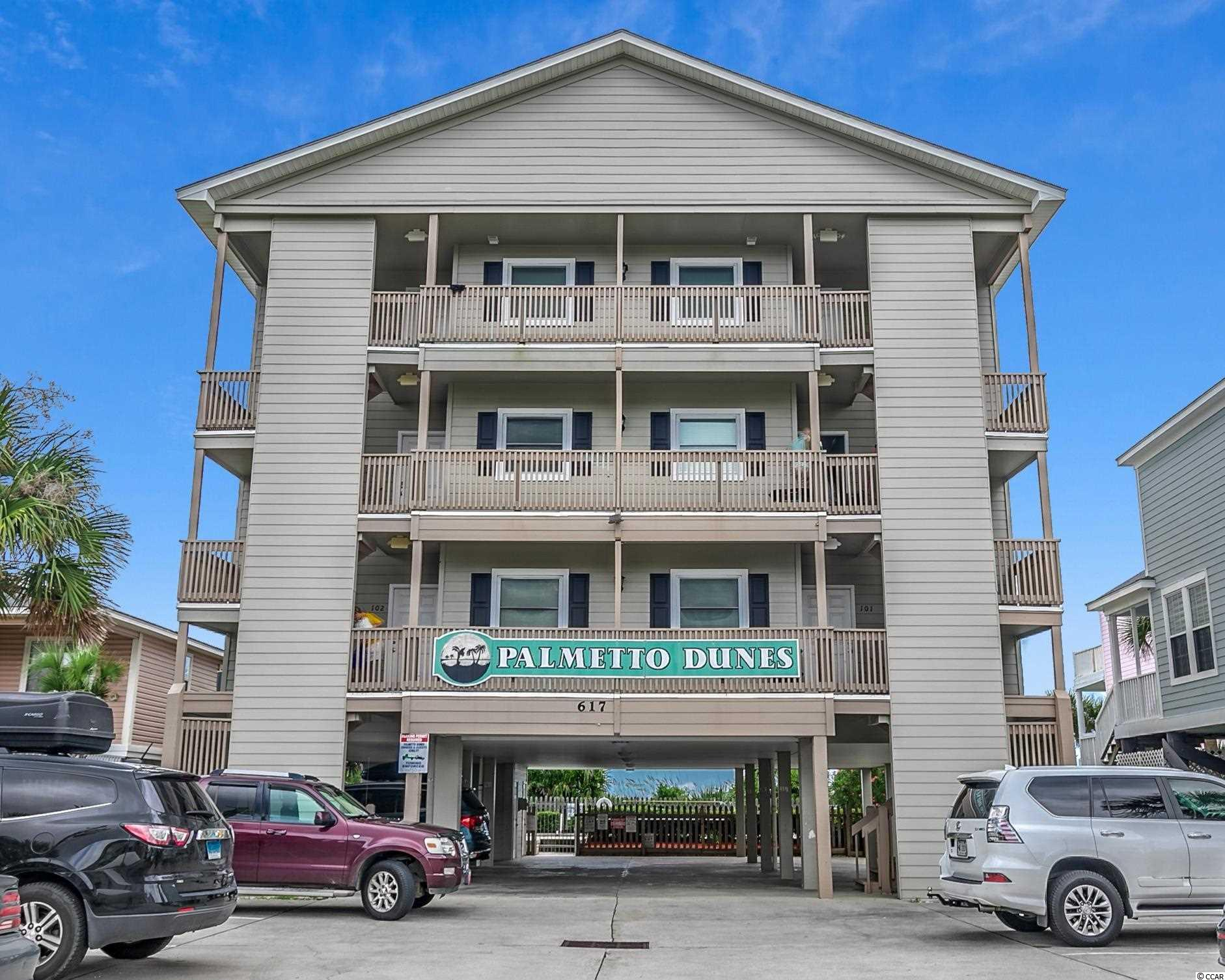 Superb views, location, and a small complex; 201 Palmetto Dunes is located directly oceanfront in the sought-after town of Surfside Beach. This second-floor end unit condominium has three bedrooms and two bathrooms, with approximately 1075 heated square feet, comes completely furnished and on a weekly rental program. This turnkey unit has the potential for high rental revenue that will defray owners' operating expenses. Why rent when you own a piece of the most pristine beaches along the Grand Strand. Palmetto Dunes is just a half-mile south of the Surfside Pier and restaurant district and is a well-maintained complex that features a large oceanfront pool, a ground-level owner storage closet, and covered parking. It also offers a warm family atmosphere with only six units in the building. The condo has spectacular views up and down the Atlantic Ocean from its private balcony with access from the living room and master bedroom. Make sure to check out the Matterport 3D Virtual Tour. It's like you're walking through the condo. Link to the virtual tour: www.bit.ly/201Palmetto