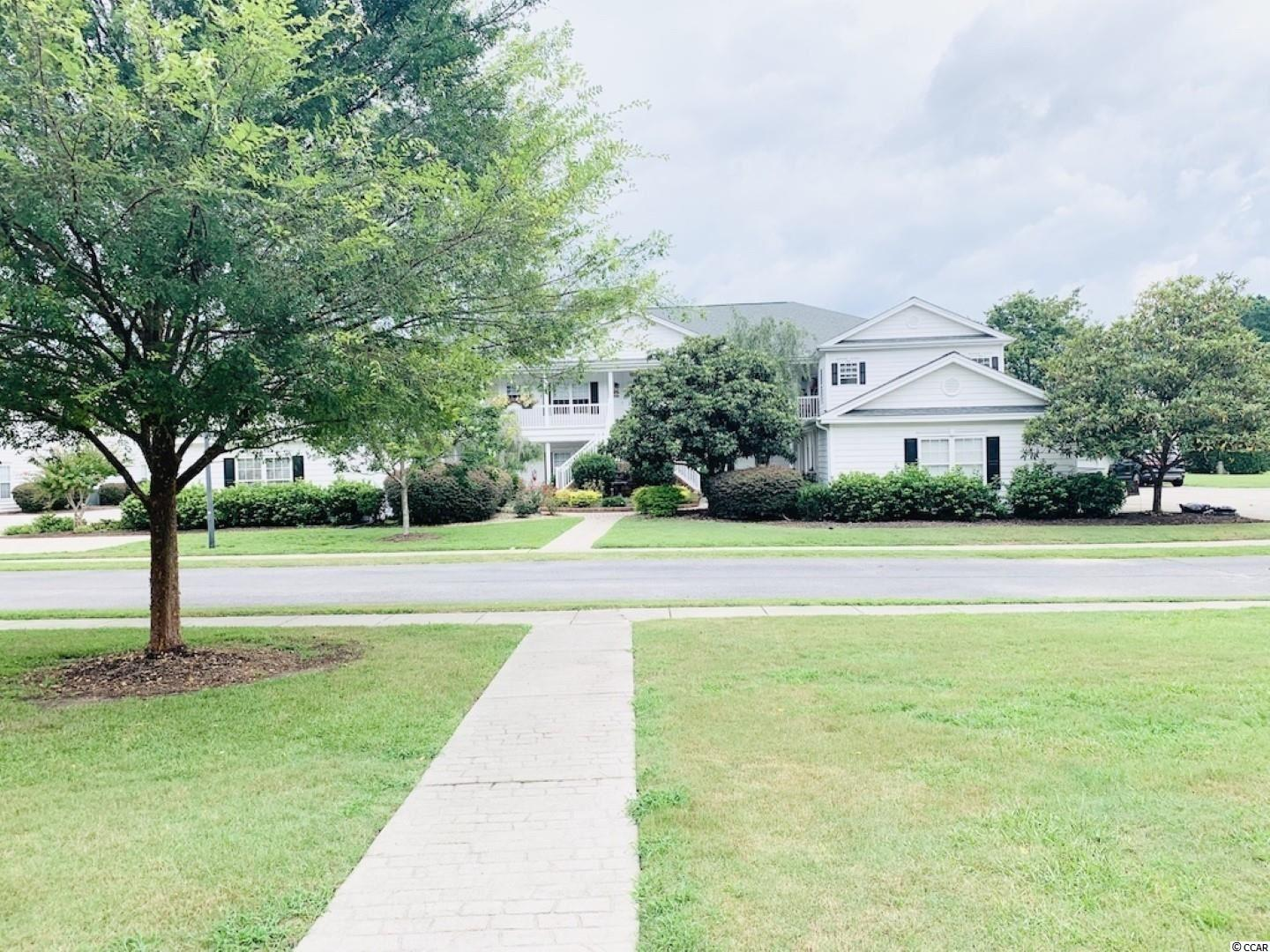 Spacious second floor condo with many special features! The 9 foot ceilings, open floor plan, walk-in closets, wood cabinets, updated appliances, and a dedicated laundry room make this condo exceptional. The bright, open floor plan and split bedroom arrangement works equally well as a full time residence or vacation home. The large screened porch spans 30+ feet along the back, has floor to ceiling storm windows, and overlooks the beautiful lake fountains. There is also a one car garage with storage and a separate parking space. The Fountains is a private gated community; the amenities include an outdoor pool and open-air cabana with an outdoor kitchen. The location is convenient to golf, dining, shopping, Tanger Outlets, Conway Medical Center, and entertainment. It's just an easy drive to the beaches too! This  home is in immaculate, move in condition and ready to enjoy! Square footage is approximate and not guaranteed. Buyer is responsible for verification.