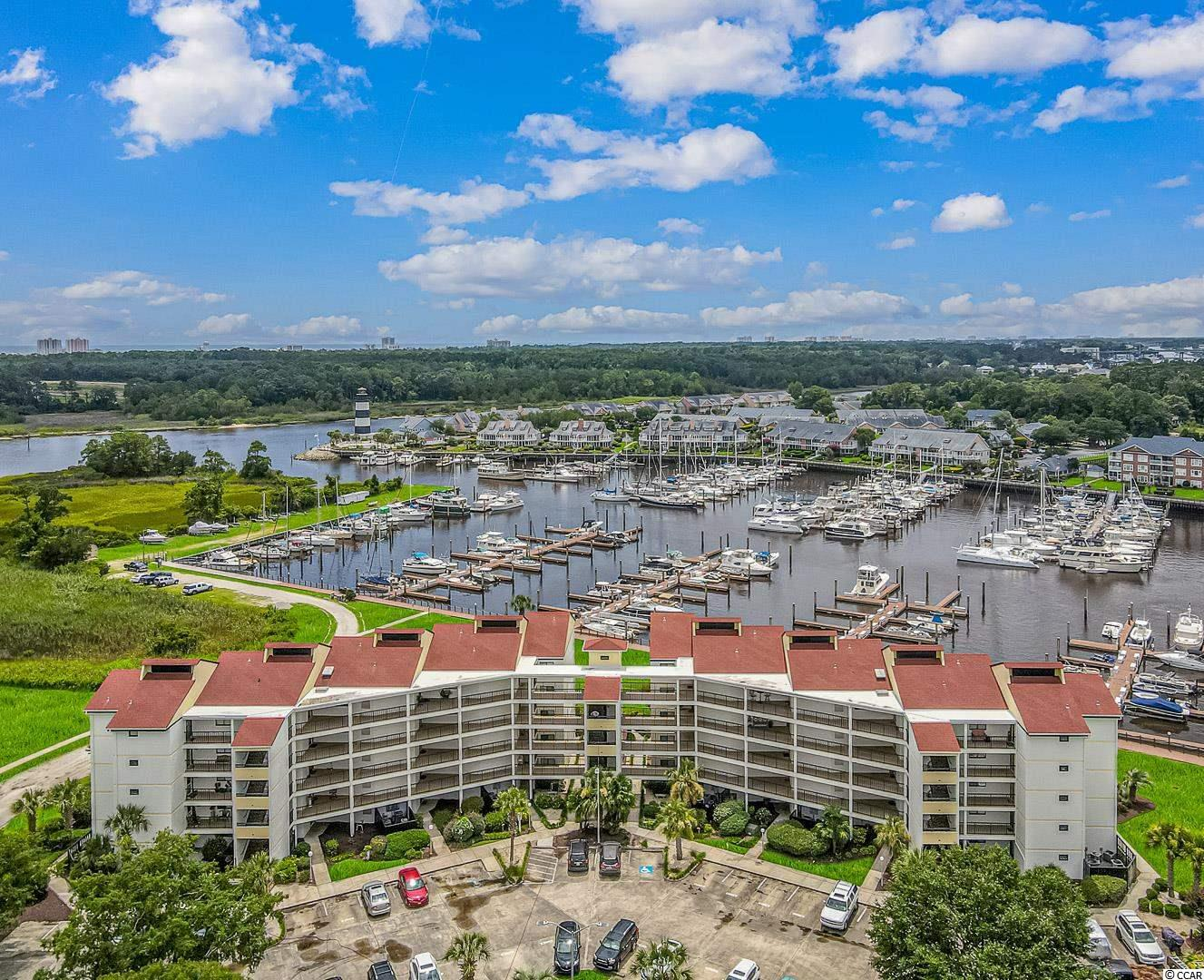 WATERWAY AND HARBOR VIEWS, UPDATED THROUGHOUT, 3 BOAT SLIPS! This gorgeous 2 bedroom 2 bath unit in the highly sought after Coquina Harbour community checks all the boxes for your new coastal lifestyle.  Located on the fourth floor in an elevator building,  this showstopper delivers views for days over the marina and the ICW!!  Spend your early mornings and late evenings on your over sized, wrap around back balcony and soak up nautical life at its best.  This unit has been beautifully maintained and upgrades include tile and laminate flooring throughout, Blanco Copenhagen granite counter tops, Samsung stainless appliance package, new cabinetry, new HVAC in 2020, wine fridge, lighting fixtures, and many more.  Looking to get out on the water and live it instead of watch it....this unit comes with not one, not two, but THREE deep water boat slips with water and electricity.  Keep your jet skis on one, the pontoon on the other and let your friends come dock in style on the third!