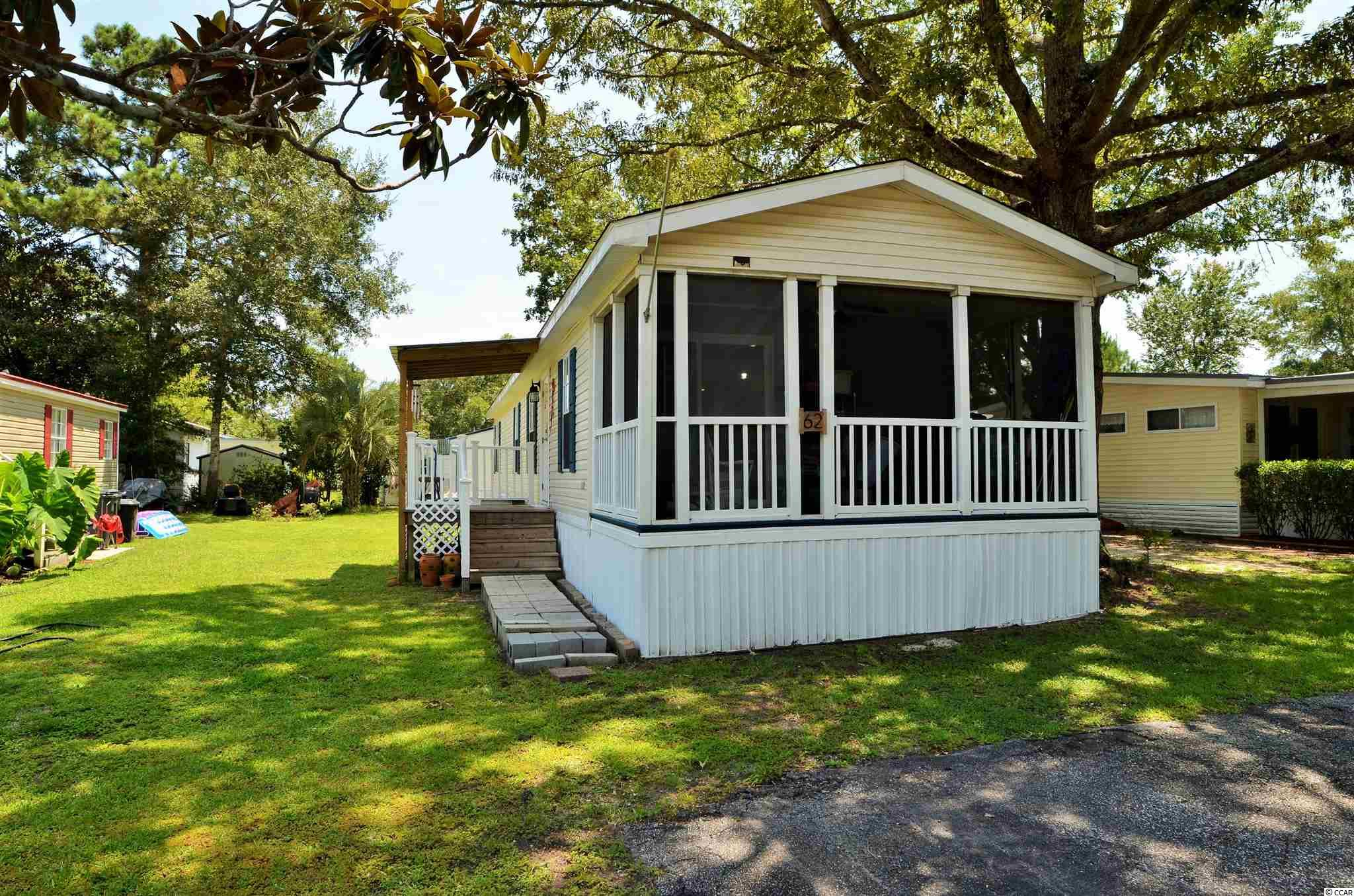 Back on market through no fault of seller's home. Location, Location, Location, this stunning remodeled home in Murrells Inlet is in the highly sought-after 55+ Captains Cove Community a few miles North of Pawley's Island and a stone's throw to the Marshwalk and Huntington State Park! This beautiful, single wide manufactured home features 2 bedrooms, 2 bathrooms. The open floor plan features an open kitchen and living room space, beams, high ceilings, vinyl flooring and shiplap throughout. The newly remodeled kitchen comes with a new stainless-steel range hood, white subway tiled backsplash, beautiful Carerra marble countertops, new light fixtures, and custom shelving. There is also a very spacious screened in porch just off the kitchen so you can enjoy your morning coffee or evening dinner and a metal roof covered private side deck with new entry door. The shiplap and custom shelving have been carried throughout the bathrooms and laundry room to compliment the barn doors in the master bedroom closet and bath. The Goodman HVAC system has just been serviced and is running great. This is one of the Newest Mobile Homes listed in the last 60 days in Captains Cove don't let it slip by!!