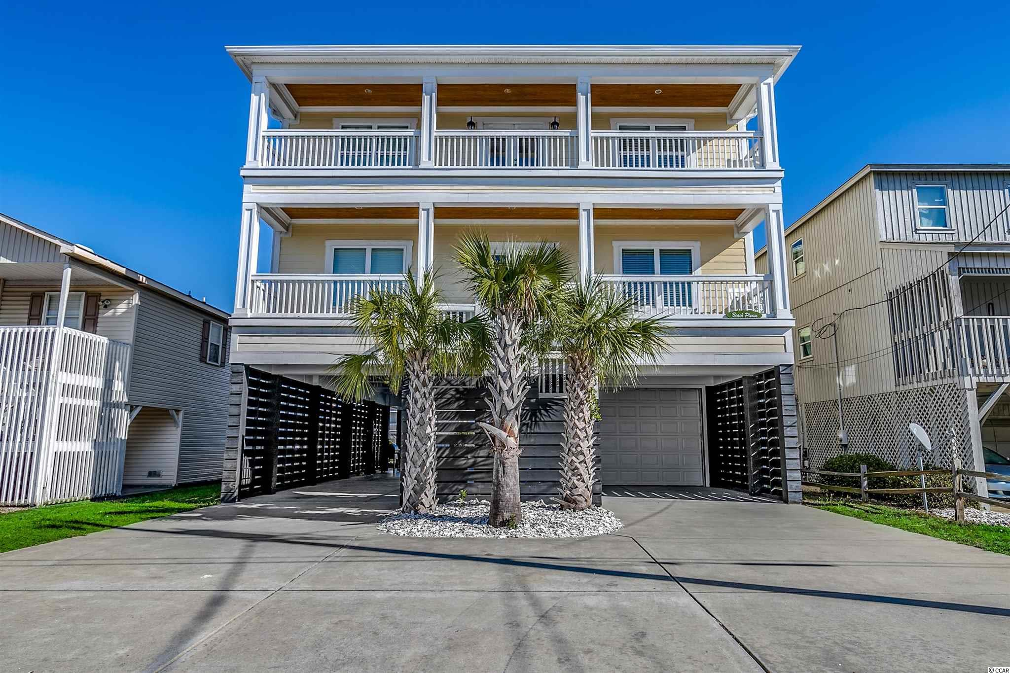 Walk to the beach! Here is your chance to own a gorgeous 6 bedroom and 6 1/2 bath raised beach home on the channel with ocean views. This beautiful property in Cherry Grove is a rental machine producing well over six figures annually. Sit back and enjoy the views from one of your four porches while you breathe in the salt air. This fully furnished home has everything that you will need including, outdoor furniture, hardwood floors, granite counter tops, custom shower, outdoor faucets on each deck to water your plants, beautiful back patio pavers and a custom bar on the ground level for entertaining to top it all off. This beach home was built to entertain!!! Priced to sell immediately! Don't miss your chance.