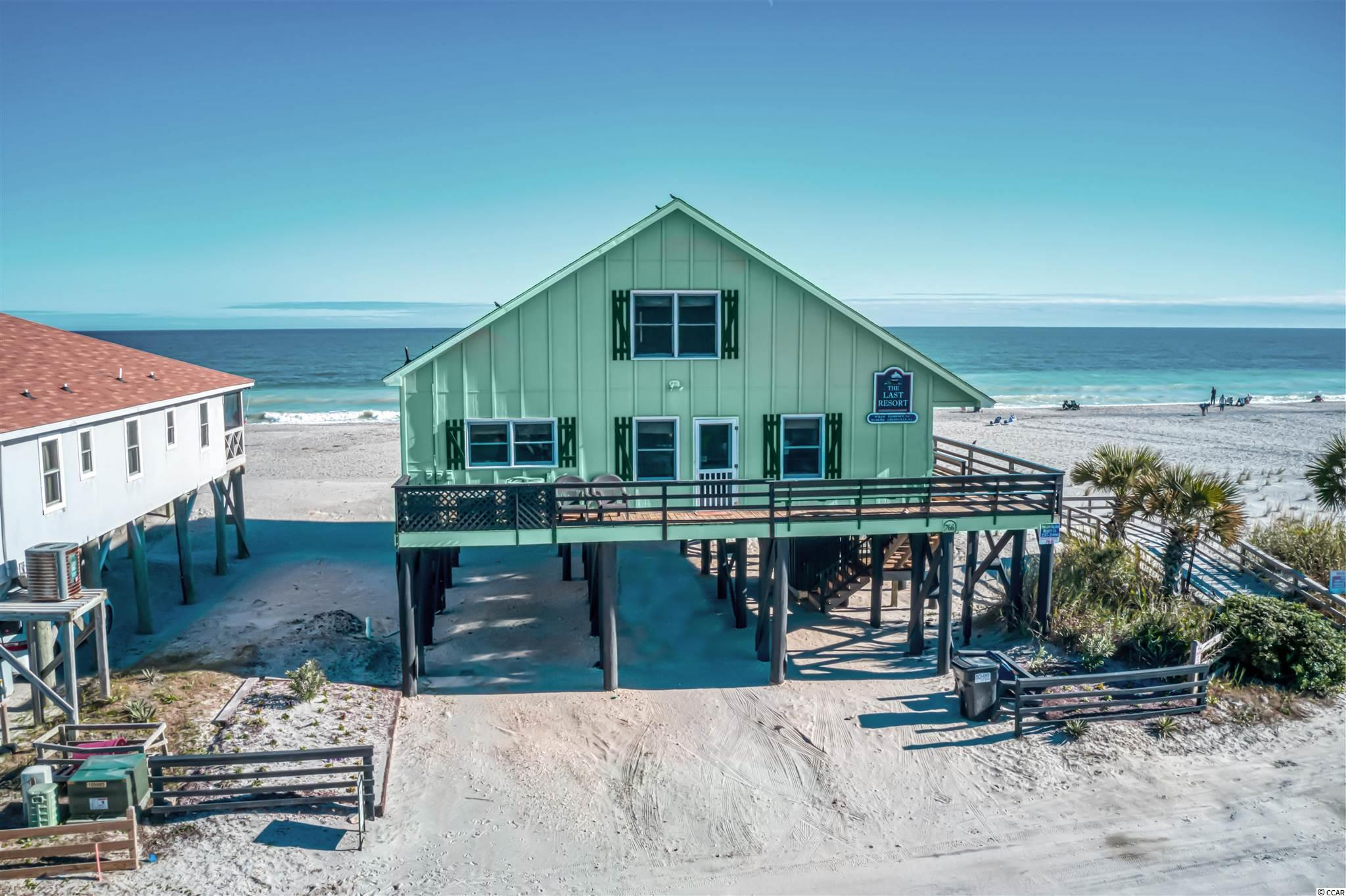 """Dont' miss your opportunity to purchase this wonderful 6BR 3 Bath home on the beautiful South End of the Island. It's one of the few Remaining Oceanfront and Creekfront homes available. Spectacular Sunrise and Sunset views from this Location! Affectionately known as """"The Last Resort"""" you will have full access to everything that Stunning Pawleys Island has to offer! You'll make treasured memories for a lifetime fishing and crabbing at the one of the best fishing docks on the Island! Launch a Skiff, Paddleboard, Kayak from your Creekside Dock w/ Floater that was redone in 2015. Throw a cast net for bait or catch fresh local blue crabs for dinner. Relax in the afternoon floating down the creek on a tube. On the Ocean side take a sunrise walk with the dog, enjoy an evening run on the beach, or simply soak up the sun! The possibilities are endless! The wrap around porch and balconies will become your favorite place to start and end your day. The exterior was recently painted and there's plenty of Parking for everyone. The outside shower is a nice feature that be used by owners and guests alike. Two of the A/C units were replaced in 2018 and one in 2017.  As you move into the home is has lots of open space and is made for families gatherings. The Living Room, Kitchen, and Dining areas have an indoor Tiki Hut style decor, and family dining around the table for ten is where the stories of the day will be shared. The Home will sleep 12 comfortably and has repeat vacationers year after year. The Bedrooms are spacious & 3 Full Baths will take care of your crowd. There are Spectacular Views from every room! This Raised Beach Home has Excellent Rental Income so ask your Agent to share it with you. If you are looking for a Beach Home that reflects all the Charm and Character of what Pawleys Island is every time you step foot on the property, this one is for you! Call for your appointment to see it and start making your own Beach memories today!"""