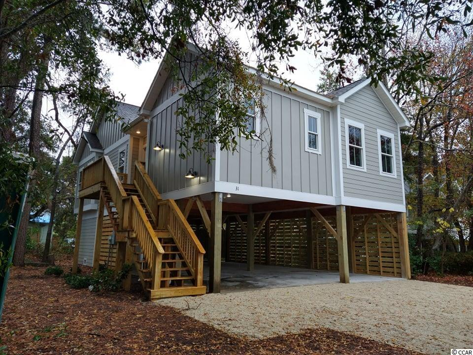 Brand new beach cottage ALERT!  Custom design & build by a premier custom home builder in Pawleys Island!  Ms. Seagrove features a raised style foundation with over 1400 sqft of covered parking, three bedrooms, two and a half bathrooms, and a beautiful kitchen that overlooks the great room.  Other features include an open floorplan concept w approx. 1470 heated sqft, split design gives the owners retreat space from the two spare bedrooms, granite countertops, LVP Flooring in the common living (kitchen, great room, entry, and dining areas), and master bedroom suite, ceiling fans in great room, master and all other bedrooms. In addition, the bathrooms will feature tile flooring, and the powder room may feature LVP. Other notable features include a large lot, Hardi Plank siding with Board & Batten, and lap siding details.  This house is already underway and has a tentative completion date of 90 days. However, the completion date can change due to the availability of materials and delivery delays.  Builder reserves the right to change specs without notice.  Call for details.