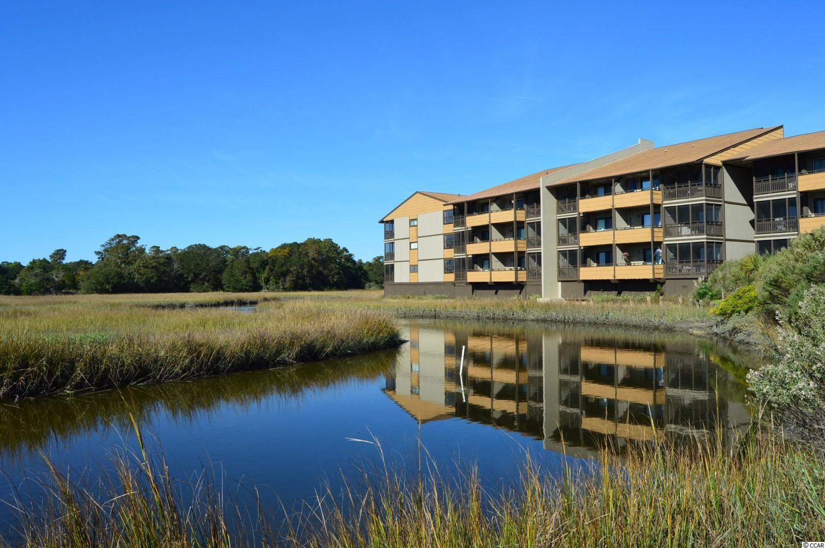 Mariners Cove Unit A-205 is a 2 bedroom and 1.5 bath condominium that is being sold fully furnished.  Coming in the front door you will pass through a foyer with wood floors that leads immediately into the kitchen.  The kitchen features an open breakfast bar that keeps you a part of the activities in the living and dining room.  The Master Bedroom has its own private balcony and with the screened in porch located off the Living room, they provide wonderful places to relax and enjoy the beautiful weather, the view of Singleton Marsh, and even a glimpse of the ocean.  This unit comes with its own detached storage room, perfect for storing beach chairs and umbrellas.  This beach home is one that you and your guests will long enjoy.  Mariners Cove for years has been one of the most popular resort destinations in the Myrtle Beach area.  Being located in the Myrtle Beach Arcadian section, owners and guests have long enjoyed the central location to great shopping like Barefoot Landing, Tanger Outlets, Myrtle Beach Mall, and Broadway at the Beach.  In addition, the location is at the center of family entertainment like the Carolina Opry, Alabama Theatre and much more.  You can drive in any direction and locate restaurants, golf courses, putt-putt and even the new Sky Wheel in just minutes.  For most, the main reason for coming to Mariners Cove is the fact that it is located right across the street from the Atlantic Ocean and some of the most pristine beaches in the south.  Please make your appointment to see this resort home.  All measurements are approximate and not guaranteed.  Verification of measurements are the responsibility of the buyer.