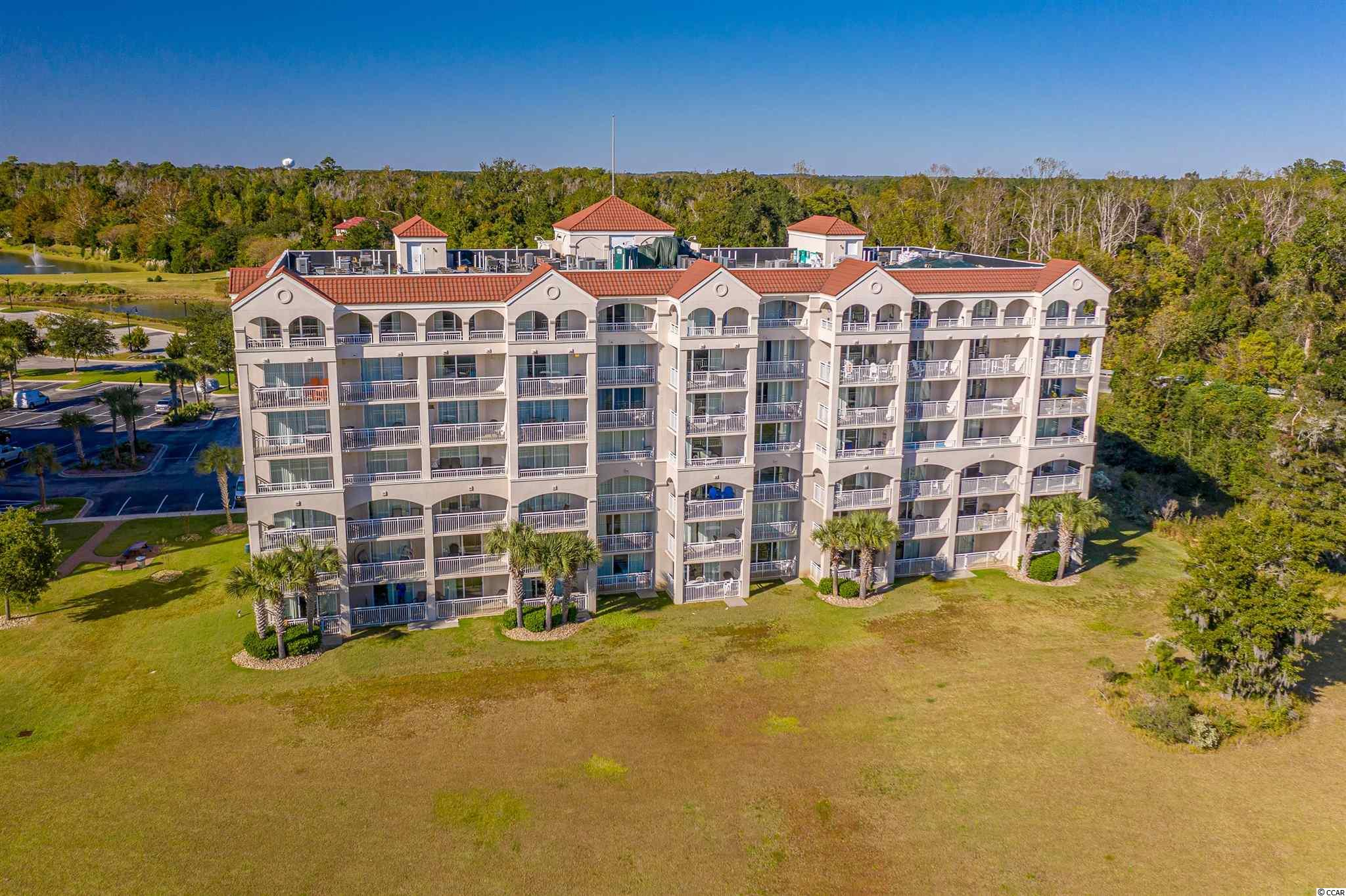 This great 2 bed/2 bath condo with a lock-out feature, is a direct Waterway unit in the Yacht Club Villas @ Barefoot, has great rental potential for investment or perfect for a second home.  This unit is so bright and beautiful that you will want to be here to enjoy this lifestyle as soon as possible!  The unit has granite countertops, stainless appliances, very light and beachy looking furniture, with awesome murals in the bathrooms (more pictures to come).  There are 2 balconies for you to enjoy the great view of the ICW and Barefoot Landing, and watching all the beautiful boats sailing right past your unit.  Yacht Club Villas is located within Barefoot Resort, which includes 4 championship golf courses, awesome driving range, with an adjacent bar and grill, a 15,000 sf pool on the Marina, a convenience store within the property.  Barefoot is located within a short distance to the Atlantic Ocean, with 60 miles of beautiful beaches along the Grand Strand, and near Alabama Theater, House of Blues, great shopping and dining.  Come and enjoy the Barefoot lifestyle, you will be glad you did.
