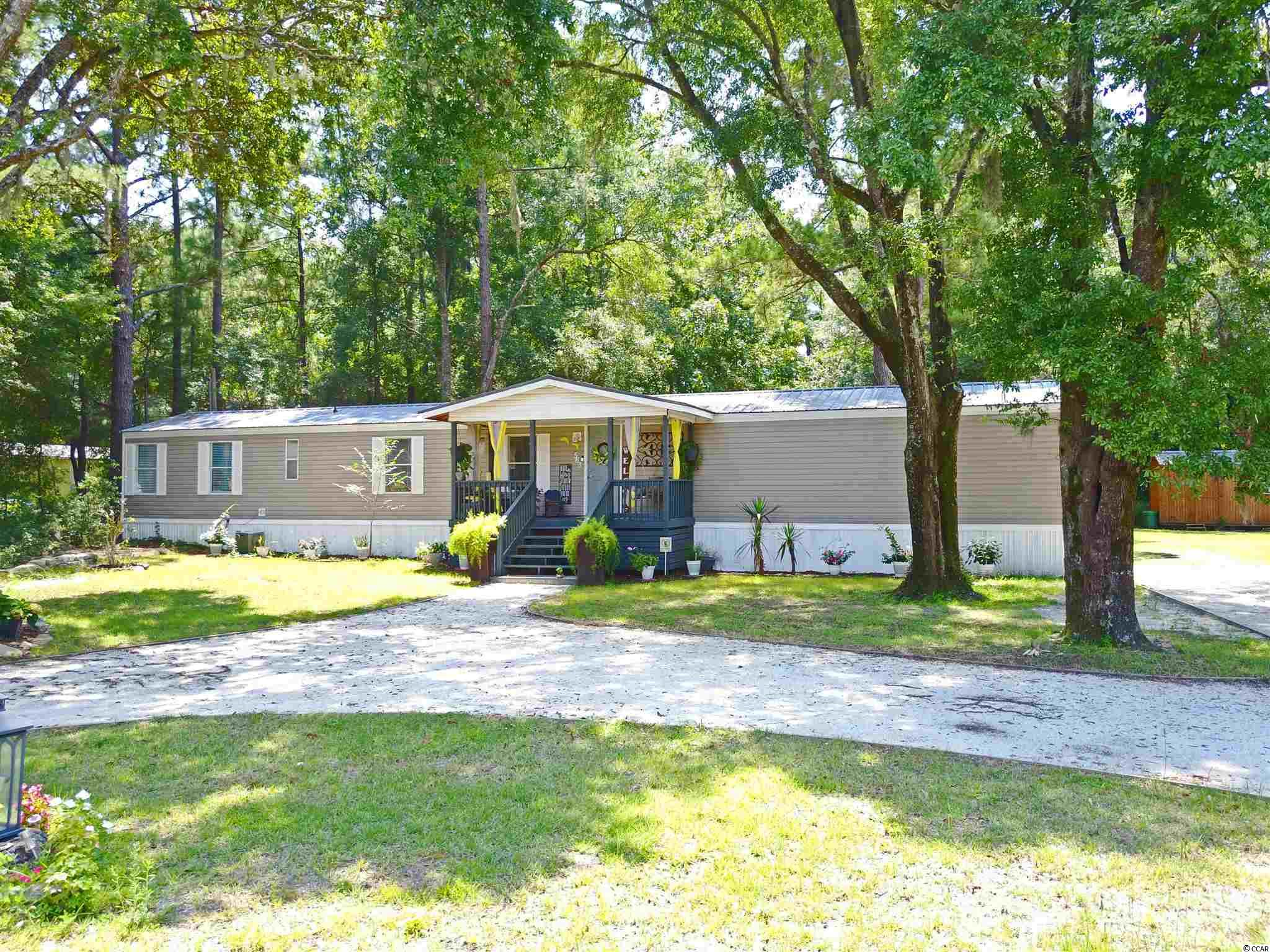 """This is a beautiful home on .49 acre of land with no HOA in the heart of Pawleys. The home is immaculately maintained, including a new roof. This 3br/2ba home features vaulted ceilings and 2 very large bedrooms, with a smaller 3rd br that could also be used as an office. The living room and kitchen are both very spacious and boast an open floor plan. The lot is shaded and allows for plenty of room for outdoor activities! There is a new double tiered deck for grilling and entertaining. This home is a must see and is easily a golf-cart or bike ride to the beach or the nearby shopping center, which includes a grocery store. Be sure to take the 3D virtual tour! Tap/click on circles to """"""""walk"""" through the home! Click on walls to turn around or look at floors and ceilings! Just like being there!"""