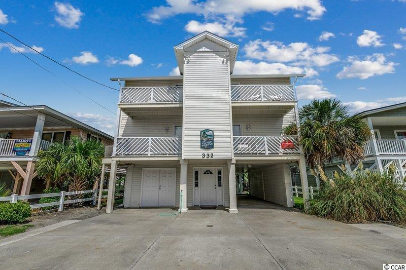 Welcome to The TipSea Turtle on the channel in Cherry Grove only steps to the beach! This 4 bedroom 2 full bath  home features a large ,unique spacious floor plan with many upgrades including new hardwood flooring, new composite standing dock, new gangway, new wiring for  exterior flood lights, hot water heater 2 years old, new custom front door, new double garage doors and side garage door, all outdoor outlets are GFI. Fully equipped kitchen with new stove , garbage disposal and breakfast bar.  Each bedroom has its own private balcony.  You will love relaxing on the large covered back porch while taking in the amazing views.   Outdoor shower to rinse off after a day at the beach. Just a short walk to boat landing and Heritage Shores Wildlife Preserve.  Perfect home for a primary residence, 2nd home or investment. Don't miss out on this one, it won't last long!