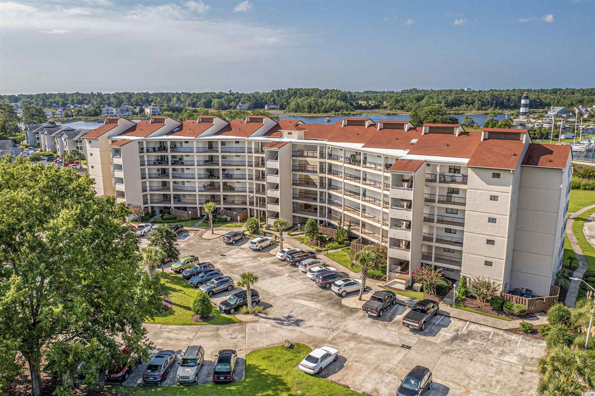 """The views from this unit will make you want to say """"Ahhhhh"""" as you relax on the wrap around porch overlooking the marina, Lighthouse, pond and enjoy the calming waterway views! This lovely unit has been freshly painted and cleaned and has been a great long term rental investment for the owners for several years. Whether you are looking for a new place to call home, a second home to build many happy memories, or an investment property to add to your portfolio you can't go wrong with this unit! You not only get the serene water views this unit offers but if you are an avid boater you can keep an eye on your boat in your very own boat slip. There are not many units available in Little River that come with a slip so you will want to hurry....this one will not last long!"""