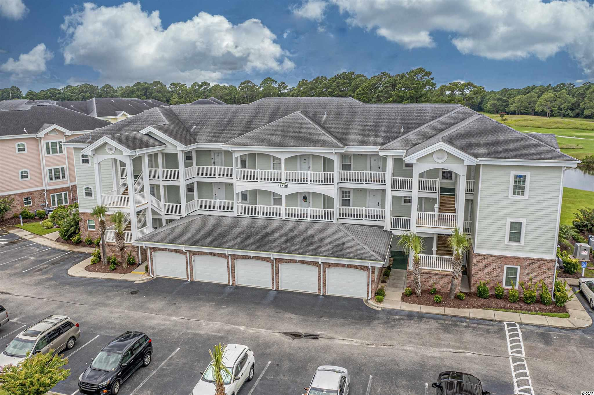 Welcome to Magnolia North a beautiful on golf course community located just west of Hwy 17 bypass just north of 48 Ave N. in Myrtle Beach. This very well maintained 3 bedroom, 2 bathroom fully appointed and furnished end unit condo features a private 1 car garage. Have your morning coffee on your private balcony with views of the pool, Pond and golf course. From the moment you step inside you will feel right at home. less than 1 mile to both the beautiful beaches of the Grand Strand and Broadway at the Beach entertainment, shopping, and restaurants. this is a must see. We all know inventory is low and this one won't last long. Do you need more information on this home, VIRTUAL TOUR VIDEO or HOA Documents? Please contact the Listing Agent OR your real estate professional today! All measurements and data are deemed reliable but are not guaranteed, purchaser and or purchaser's realtor to verify.
