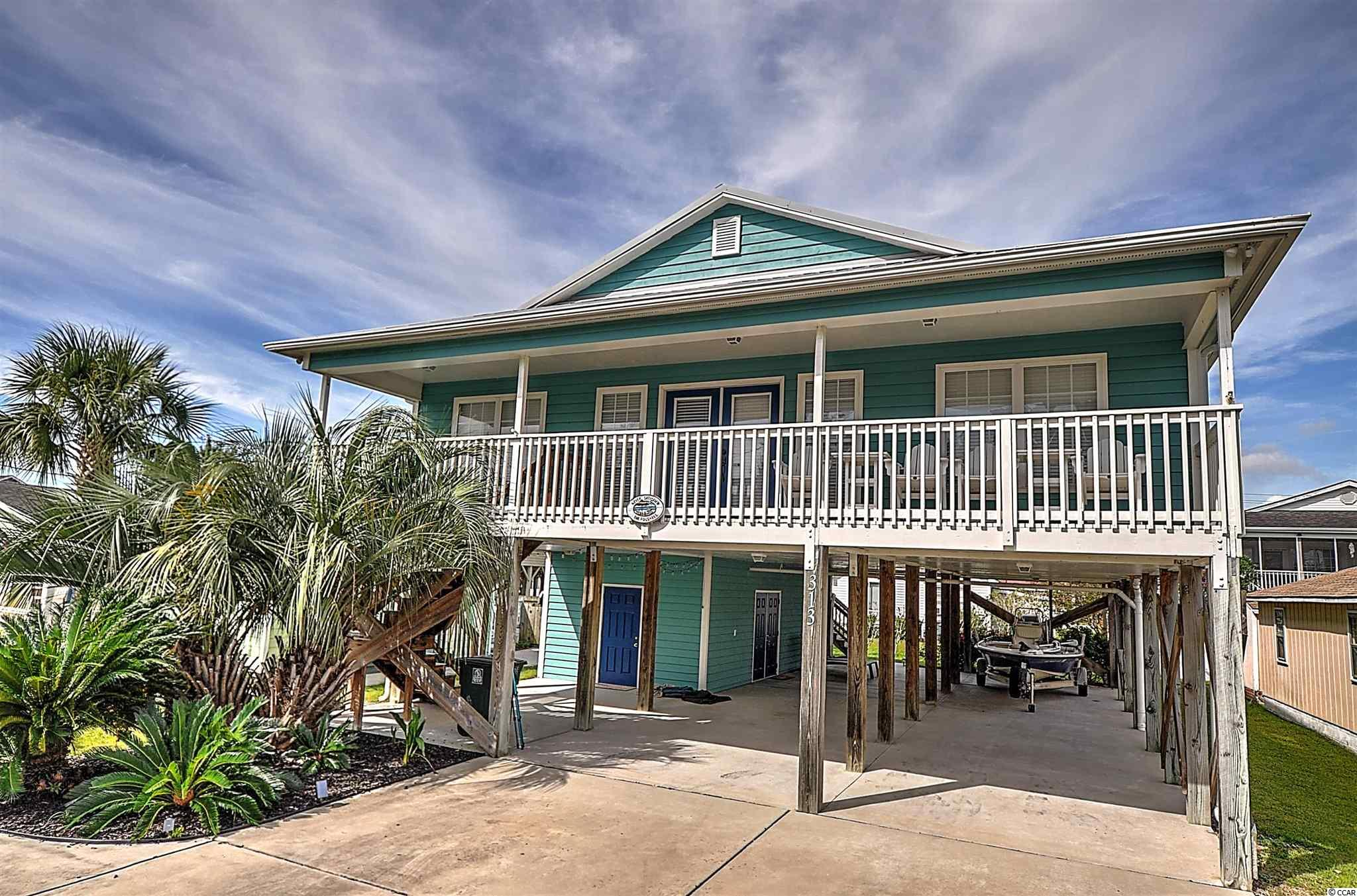 So close to the beach and Sea Mountain Hwy you literally don't need a golf cart! Roof replaced in 2013 with metal roof, HVAC replaced in 2020, under house storage added in approx 2015. This 3 bedroom 2 bath home is located in the highly sought after Cherry Grove Beach section of North Myrtle Beach.