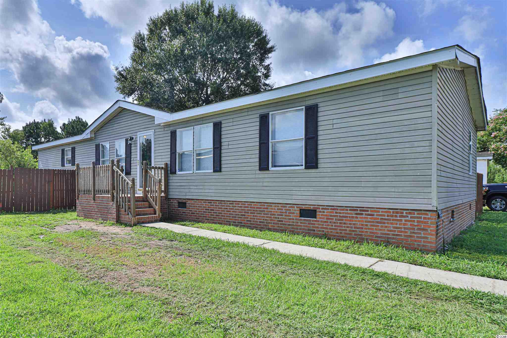 Location! Location! Location! This newly updated double wide with land has 3 bedrooms and 2 full bathrooms, an open floorplan and big fenced yard! All of this is just minutes from the beach and right at Highway 31 so you can zip over to everything Myrtle Beach has to offer without living in the middle of it. The kitchen has stainless appliances and lovely skylights that bring the natural light in. The family room has a stone fireplace that goes from floor to ceiling right between sliding glass doors and extra large double windows along with skylights! This place is light and airy! The Master suite has a walk in closet and a large bathroom with both a walk in shower and a large soaking tub to relax in. This could be the perfect place for just about anyone! Schedule your showing today!